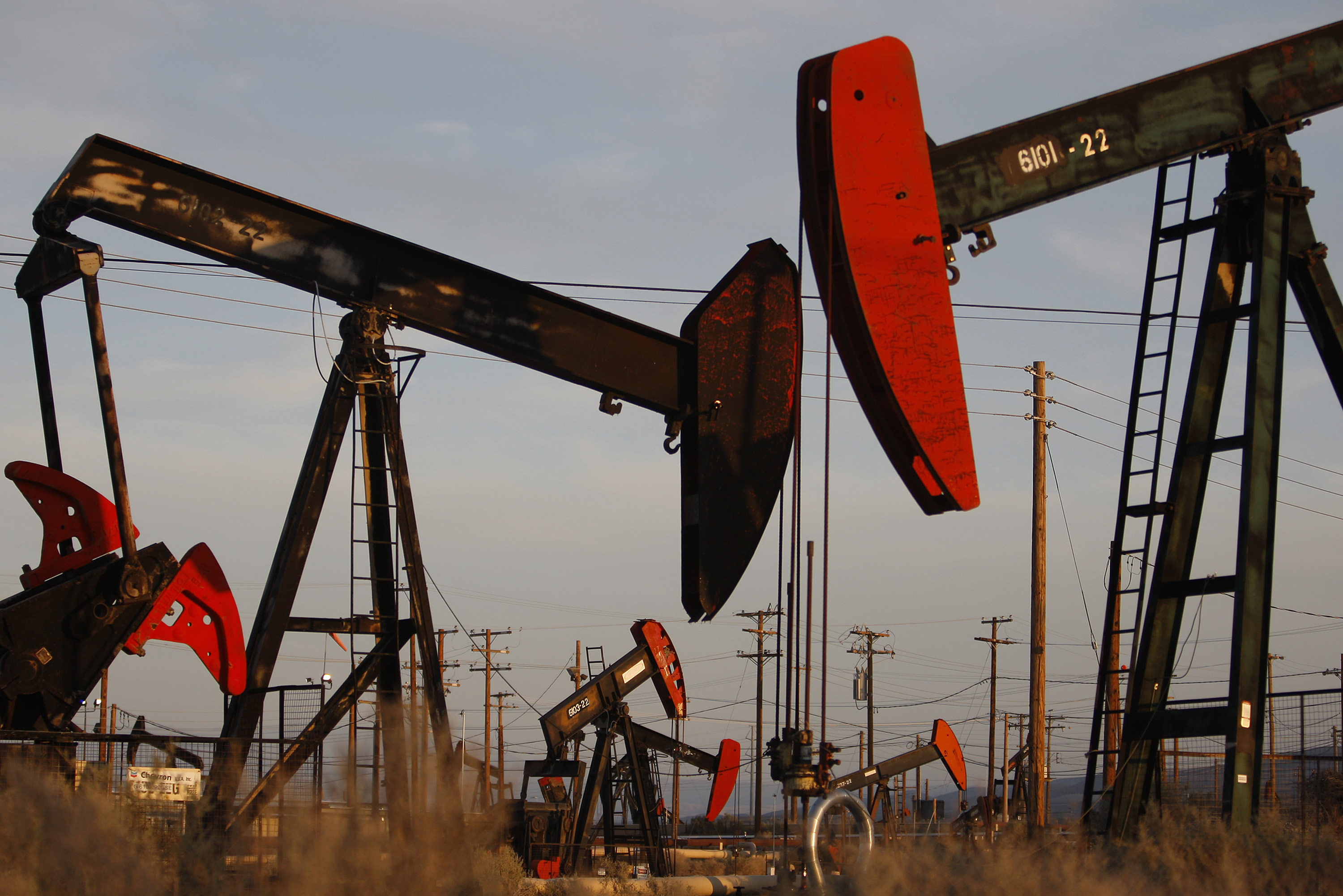 Pump jacks and wells are seen in an oil field on the Monterey Shale formation where gas and oil extraction using hydraulic fracturing, or fracking, is on the verge of a boom on March 23, 2014 near McKittrick, California.