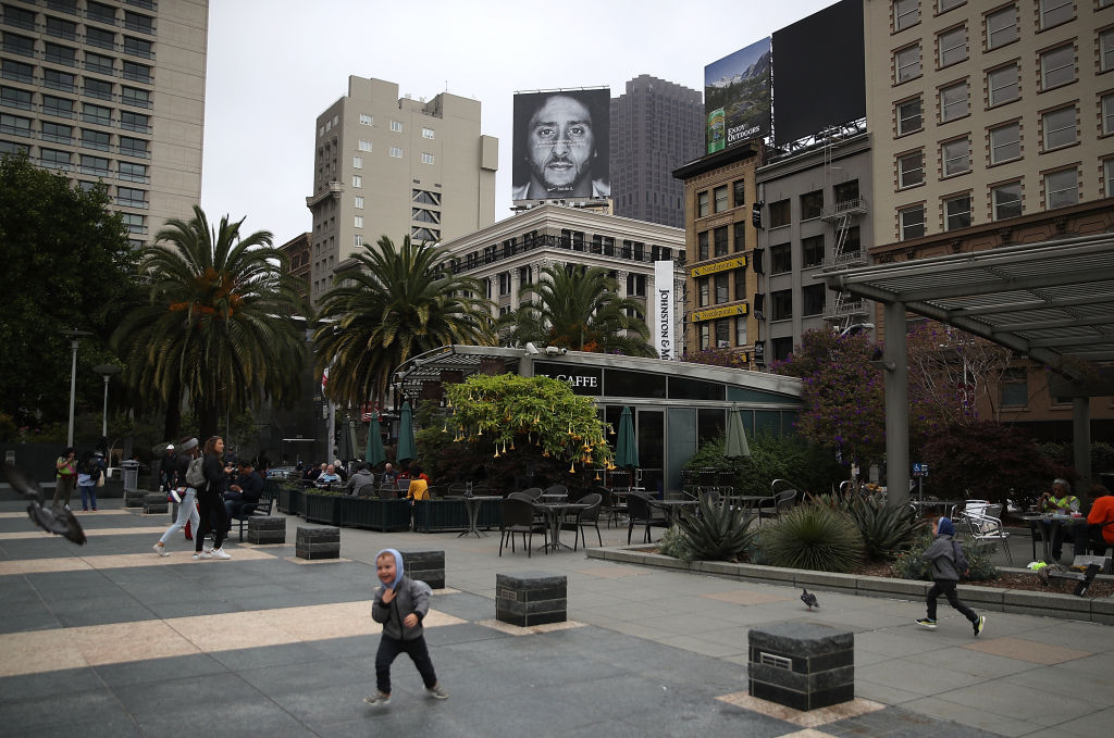 A billboard featuring former San Francisco 49ers quarterback Colin Kaepernick is displayed on the roof of the Nike Store on September 5, 2018, in San Francisco, California. Nike launched an ad campaign to commemorate the 30th anniversary of its iconic 'Just Do It' motto that features controversial former NFL quarterback Colin Kaepernick and a message that says 'Believe in something. Even if it means sacrificing everything.' (Photo by Justin Sullivan/Getty Images)