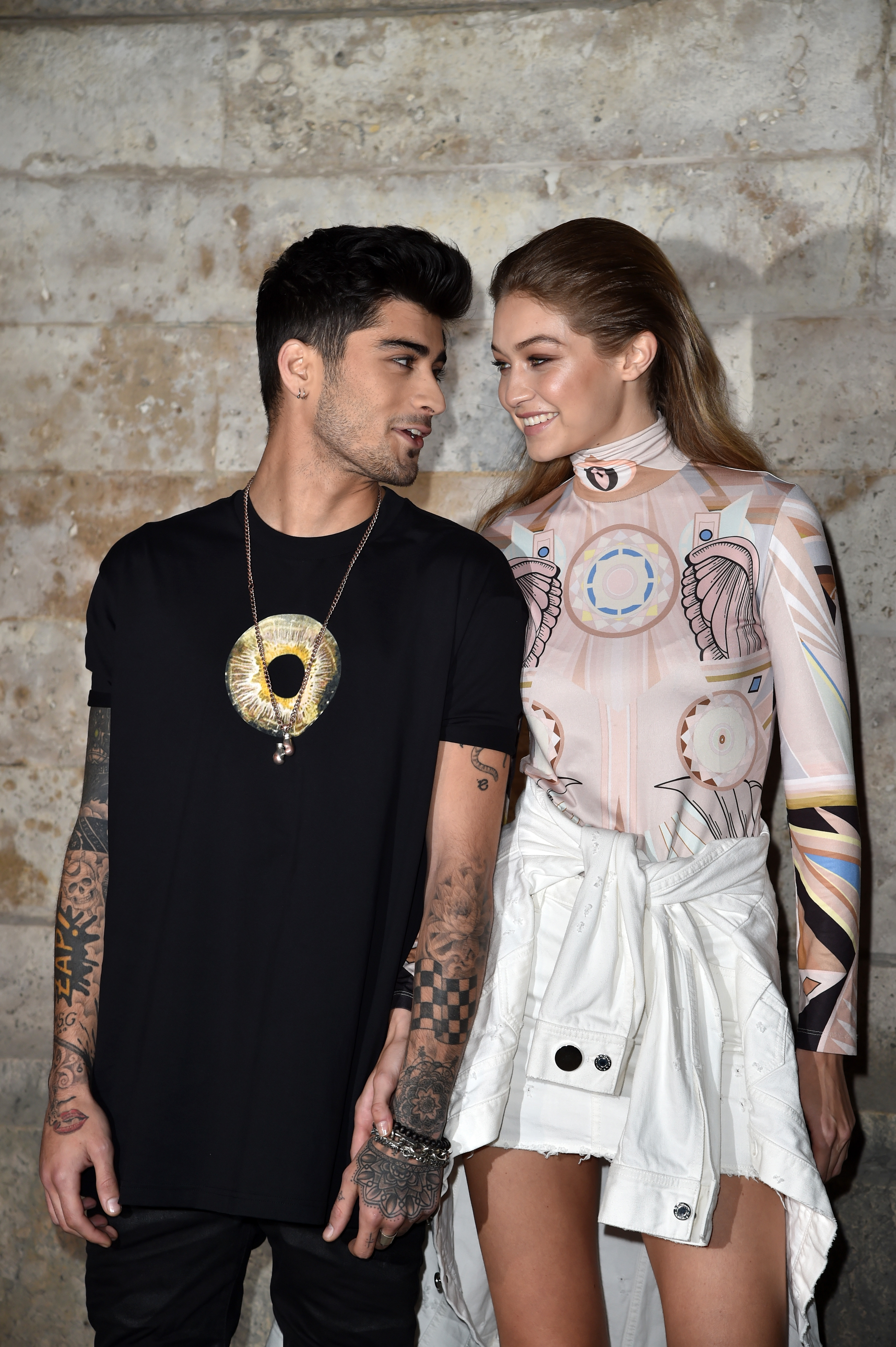 Zayn Malik and Gigi Hadid attend the Givenchy show as part of the Paris Fashion Week Womenswear Spring/Summer 2017 on October 2, 2016 in Paris, France. (Getty Images)