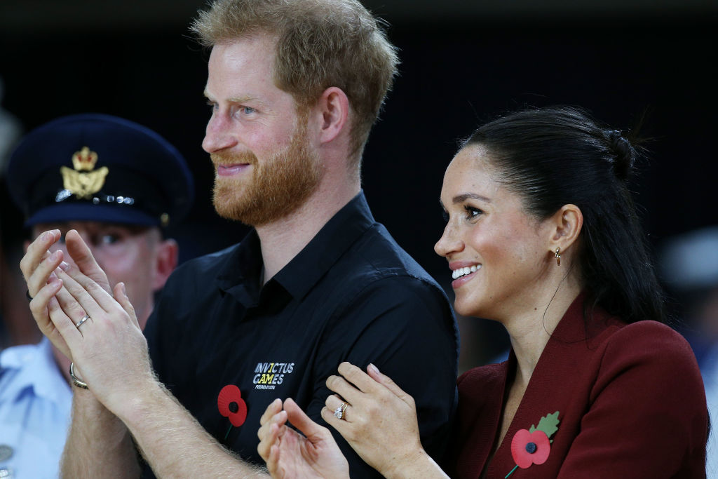 Prince Harry, Duke of Sussex and Meghan, Duchess of Sussex attend the Wheelchair Basketball finals during the Invictus Games on October 27, 2018 in Sydney, Australia. (Photo by Lisa Maree Williams/Getty Images)