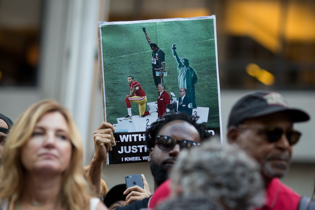 Activists rally in support of NFL quarterback Colin Kaepernick outside the offices of the National Football League on Park Avenue, August 23, 2017, in New York City. During the NFL season last year, Kaepernick caused controversy by kneeling during the National Anthem at games to protest racial oppression and police brutality. (Photo by Drew Angerer/Getty Images)