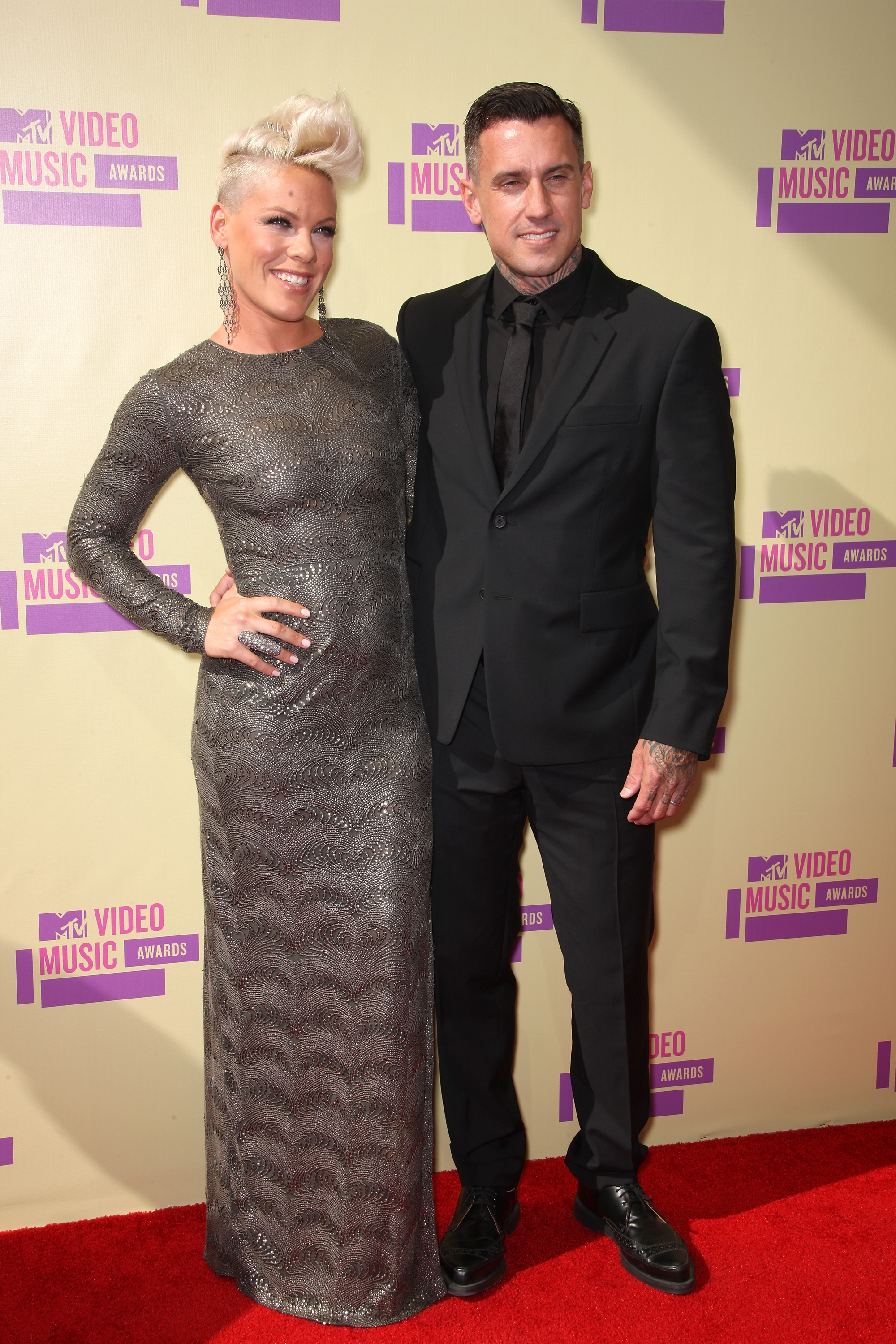 Singer Pink and professional motocross rider Carey Hart arrive at the 2012 MTV Video Music Awards at Staples Center on September 6, 2012 in Los Angeles, California. (Photo by Frederick M. Brown/Getty Images)