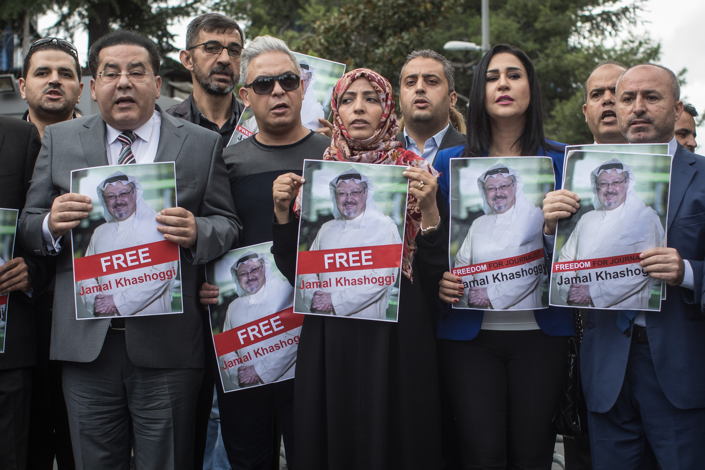 Nobel Prize winner Tawakkol Karman (5th-L) holds a poster of Saudi journalist Jamal Khashoggi during a protest outside Saudi Arabia's consulate on October 8, 2018 in Istanbul, Turkey.