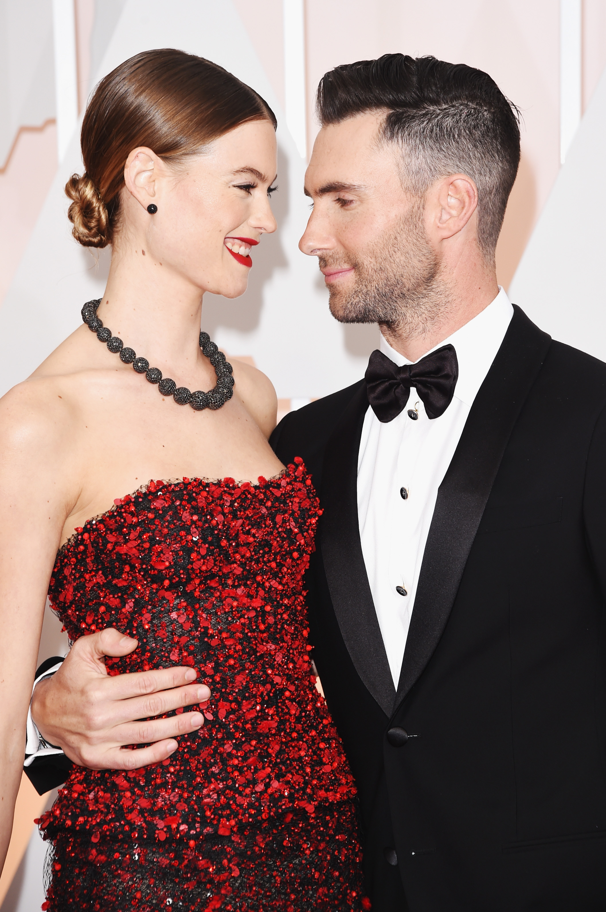 Singer Adam Levine (L) and model Behati Prinsloo attend the 87th Annual Academy Awards at Hollywood & Highland Center on February 22, 2015 in Hollywood, California. (Photo by Hubert Boesl/picture alliance via Getty Images)