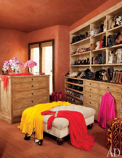 Closet:  Will and Jada's room-size closet features built-in shelving and an overscale ottoman. Roger Davies 2011