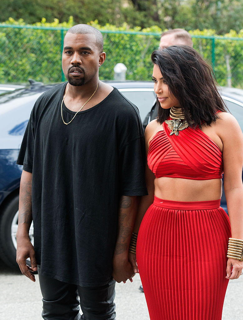 TV personality Kim Kardashian and recording artist Kanye West arrive at the Roc Nation Pre-GRAMMY Brunch on February 7, 2015 in Beverly Hills, California. (Photo by Valerie Macon/Getty Images)