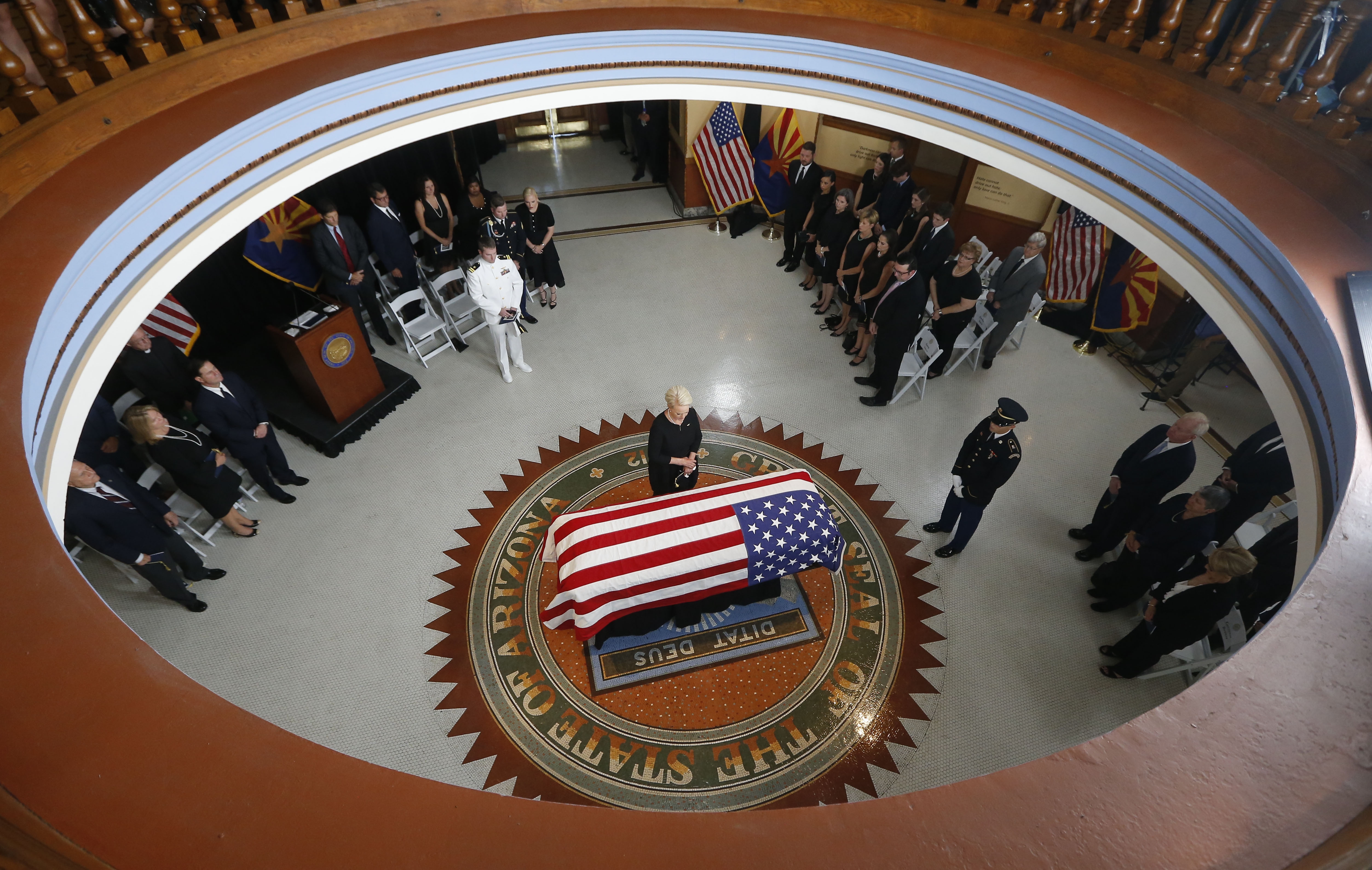 Cindy McCain, wife of, Sen. John McCain, R-Ariz. stands over the casket during a memorial service at the Arizona Capitol on August 29, 2018 in Phoenix, Arizona. Sen. McCain, a decorated war hero, died August 25 at the age of 81 after a long battle with Glioblastoma, a form of brain cancer.