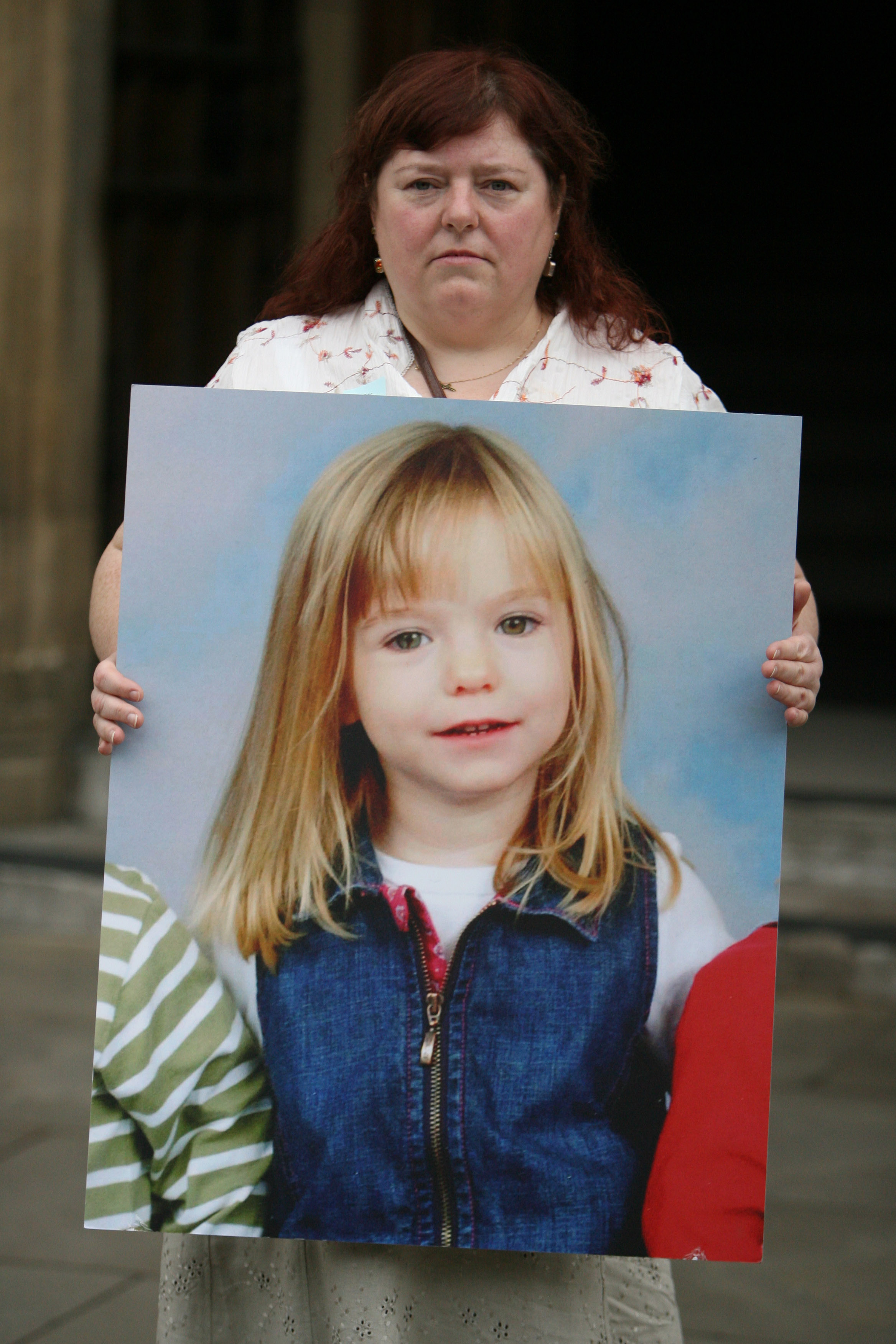 Phil McCann carries a picture of her missing niece Madeleine McCann as she visits Parliament on May 16, 2007 in London. Madeleine McCann disappeared from a holiday complex in Praia da Luz 13 days ago.