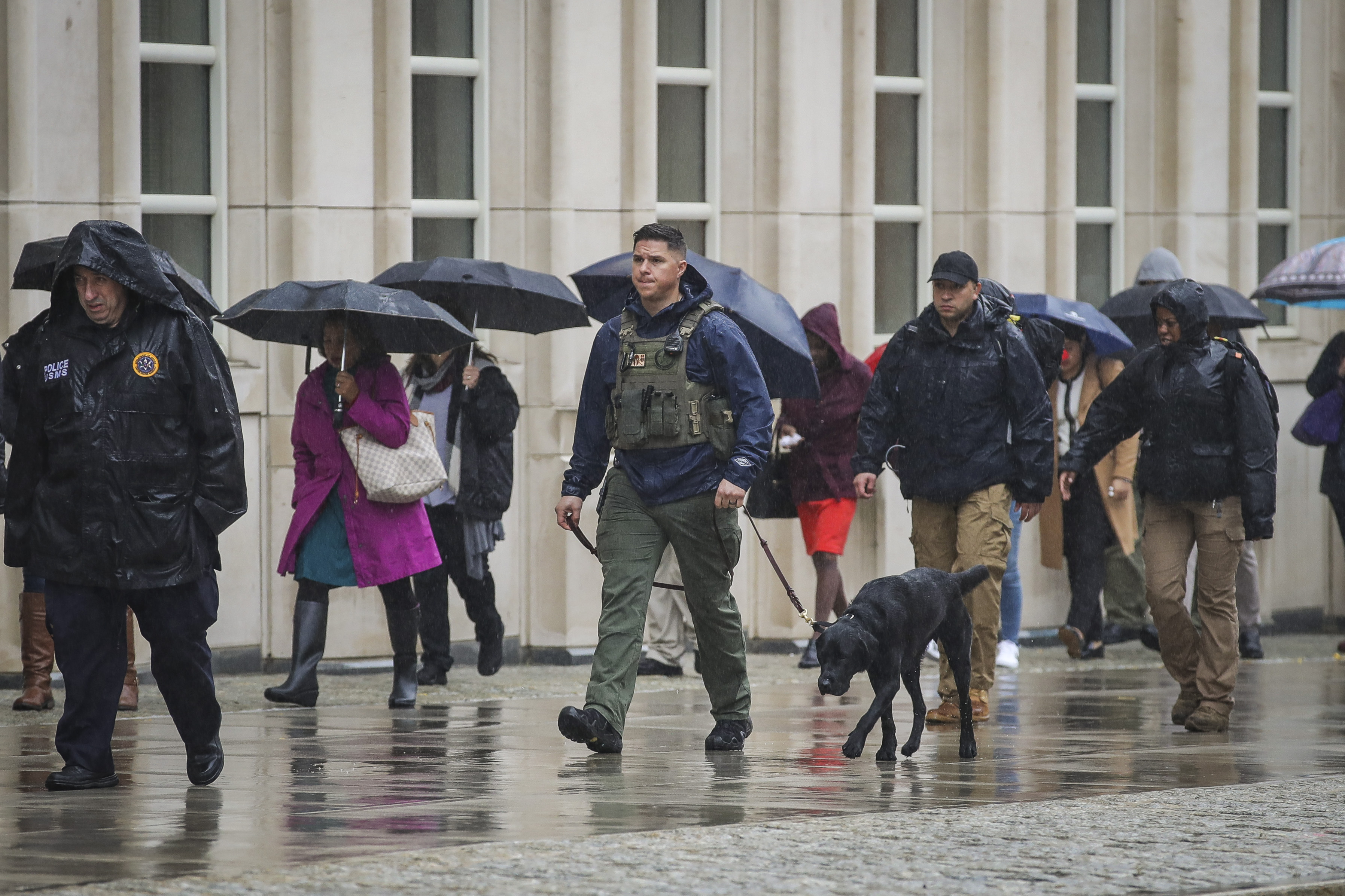 A member of the US Marshals patrols with a dog outside the United States District Court for the Eastern District of New York on the first day of the trial for Joaquin Guzman, the famed Mexican drug lord known as El Chapo in New York City. El Chapo is accused of trafficking over 440,000 pounds of cocaine, in addition to other drugs, and exerting power through murders and kidnappings as he led the Sinaloa Cartel. The trial is currently in its third week.