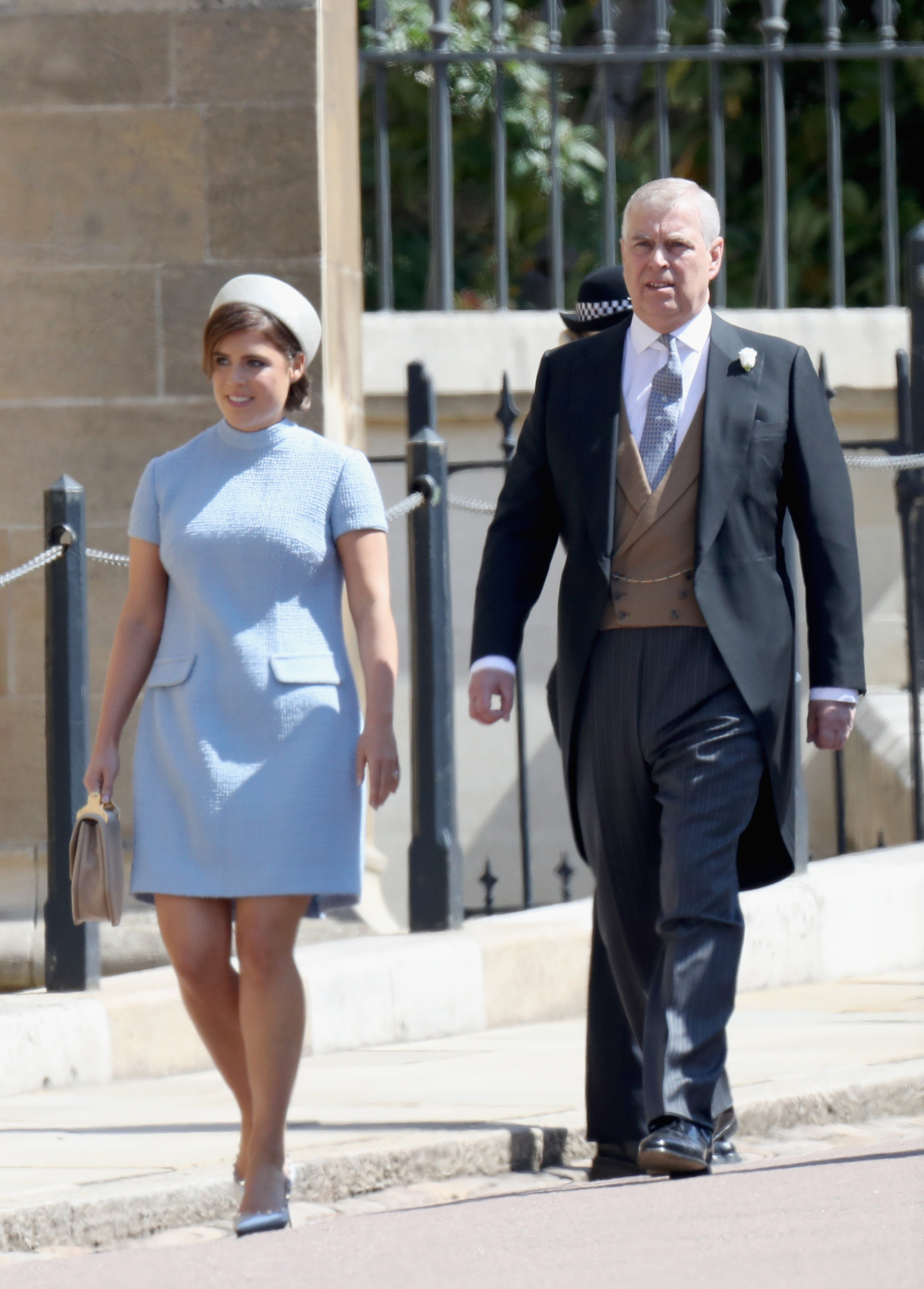 (L-R) Princess Eugenie and Prince Andrew, Duke of York attend the wedding of Prince Harry to Ms Meghan Markle at St George's Chapel, Windsor Castle on May 19, 2018 in Windsor, England. Prince Henry Charles Albert David of Wales marries Ms. Meghan Markle in a service at St George's Chapel inside the grounds of Windsor Castle. Among the guests were 2200 members of the public, the royal family and Ms. Markle's Mother Doria Ragland.