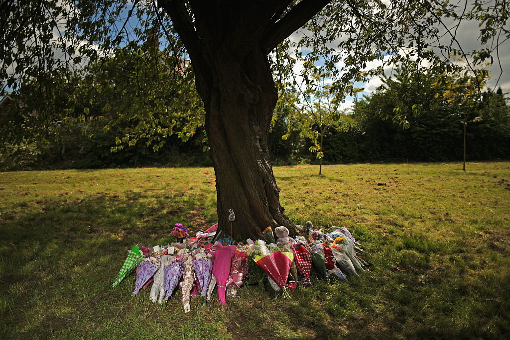 Flowers and tributes lay at the scene in Westfield Lane, Mansfield, where a body was found during the search for missing 13-year-old girl Amber Peat on June 3, 2015, in Mansfield, England. (Photo by Christopher Furlong/Getty Images)