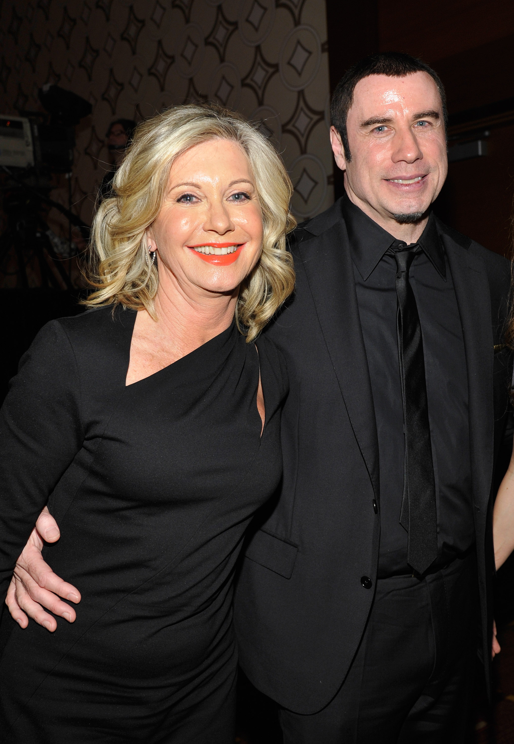 Presenter Olivia Newton-John and honoree John Travolta attend the 2013 G'Day USA Los Angeles Black Tie Gala at JW Marriott Los Angeles at L.A. LIVE on January 12, 2013 in Los Angeles, California. (Photo by John Sciulli/Getty Images for G'Day Australia)
