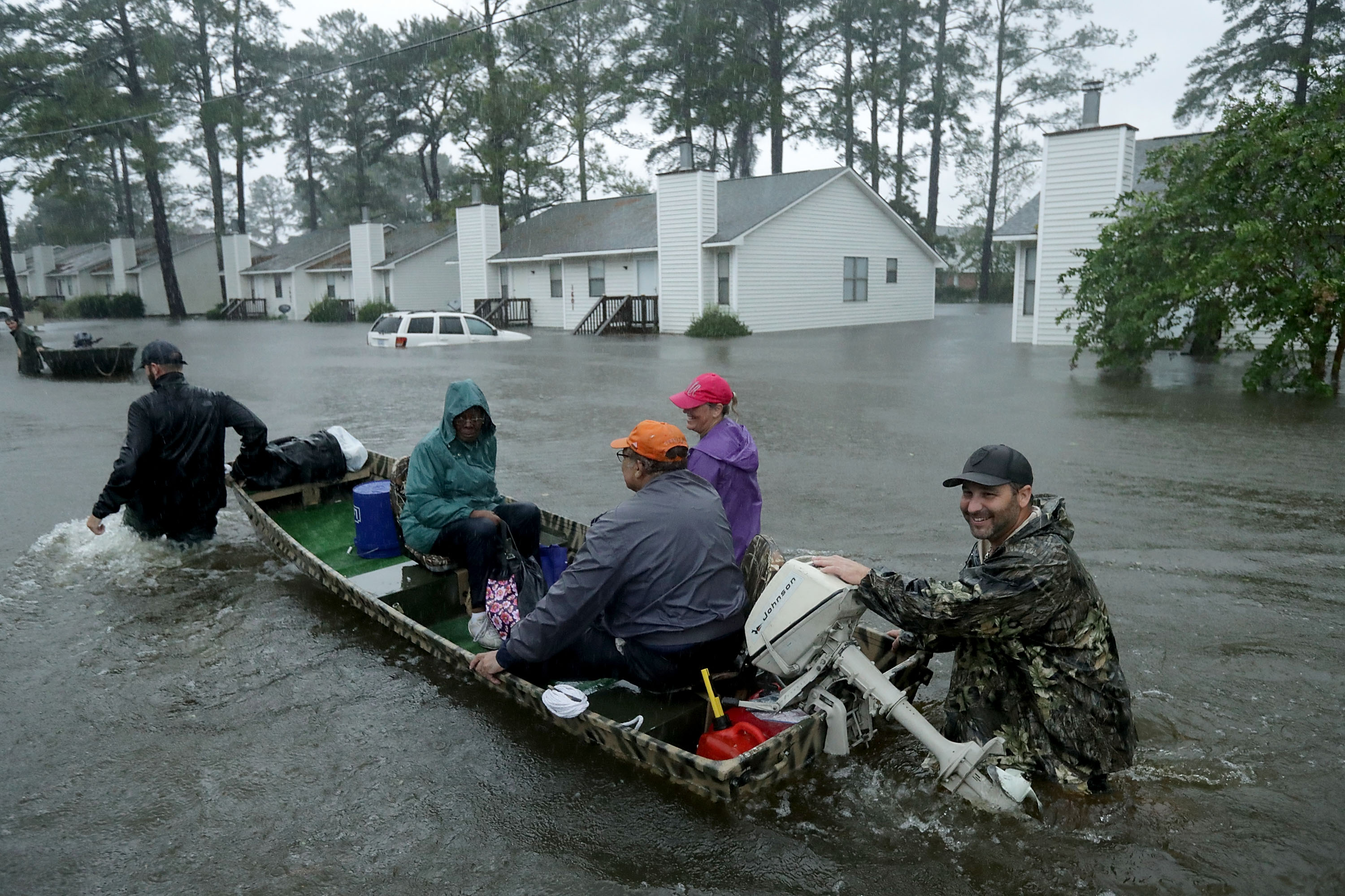 Volunteers from all over North Carolina help rescue residents and their pets from their flooded homes during Hurricane Florence September 14, 2018 in New Bern, North Carolina. Hurricane Florence made landfall in North Carolina as a Category 1 storm and flooding from the heavy rain is forcing hundreds of people to call for emergency rescues in the area around New Bern, North Carolina, which sits at the confluence of the Nuese and Trent rivers.