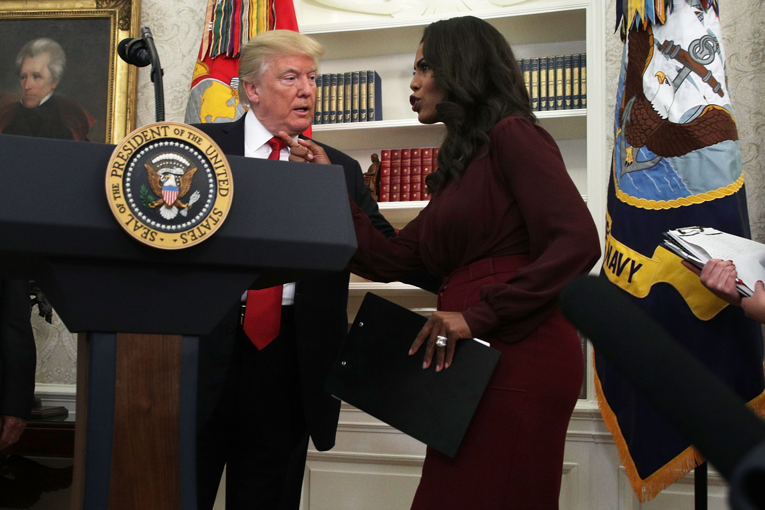 U.S. President Donald Trump listens to Director of Communications for the White House Public Liaison Office Omarosa Manigault during an event in the Oval Office of the White House October 24, 2017 in Washington, DC. President Trump honored the eight winners of the National Minority Enterprise Development Week Awards Program during the Oval Office event.
