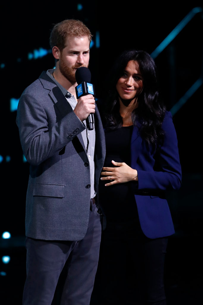 Prince Harry, Duke of Sussex and Meghan, Duchess of Sussex speak on stage during WE Day UK 2019 (Source: Getty Images)