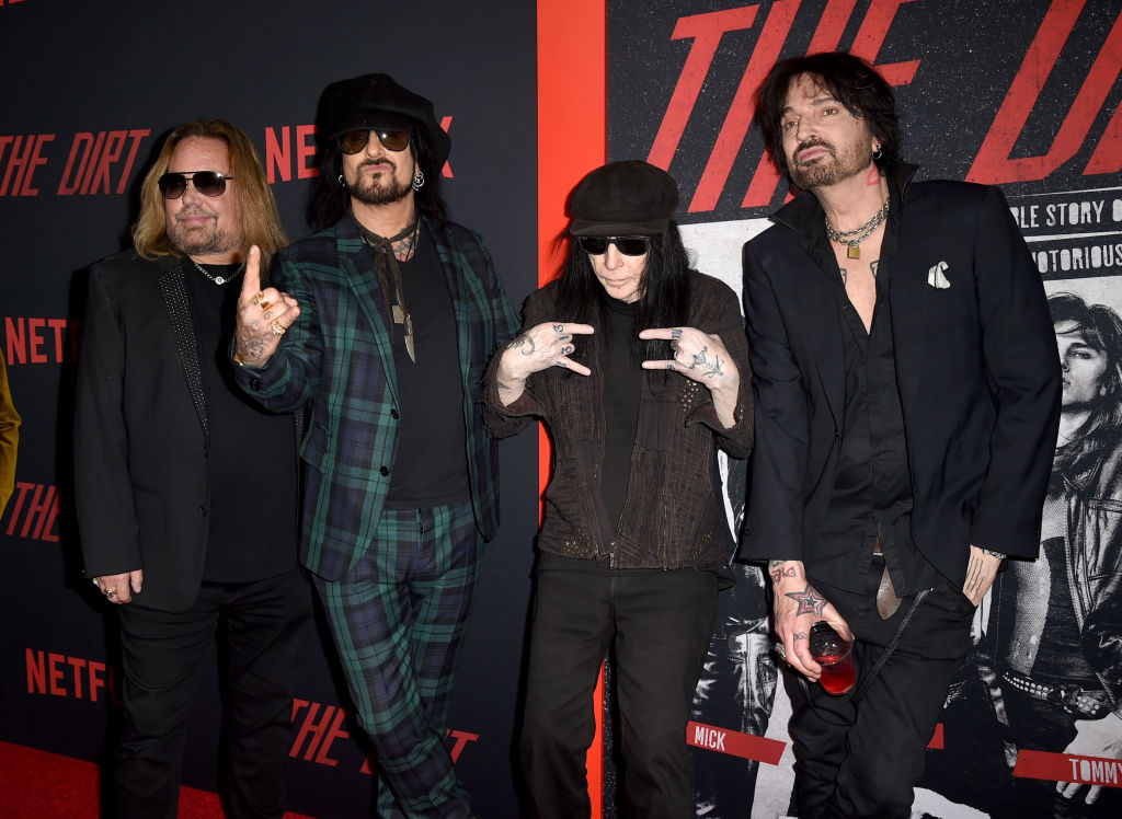 (L-R) Vince Neil, Nikki Sixx, Mick Mars and Tommy Lee of Mötley Crüe arrive at the premiere of Netflix's 'The Dirt' at ArcLight Hollywood on March 18, 2019, in Hollywood, California. (Source: Kevin Winter/Getty Images)