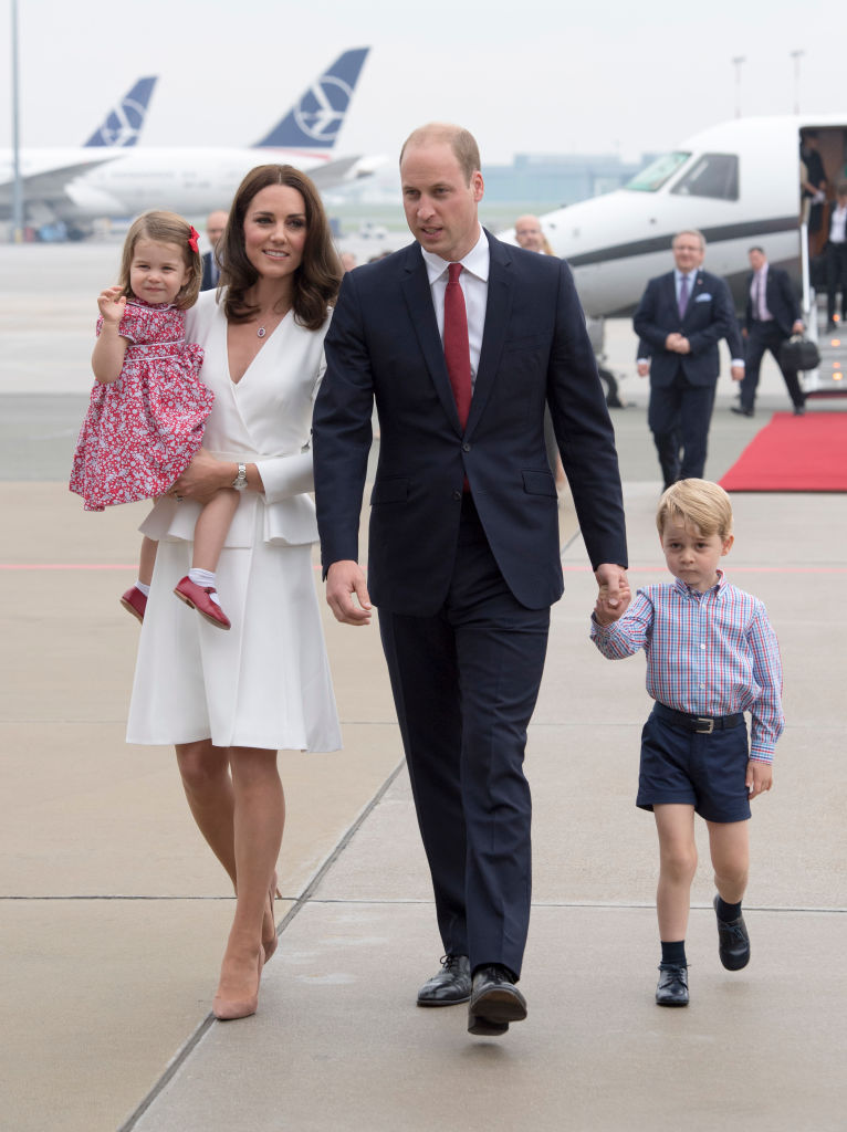 Prince William, Duke of Cambridge and Catherine, Duchess of Cambridge with their children Prince George and Princess Charlotte arrive at Warsaw airport to start a 3 day tour on July 17, 2017 in Warsaw, Poland. (Photo by Arthur Edwards / Pool/ Getty Images)