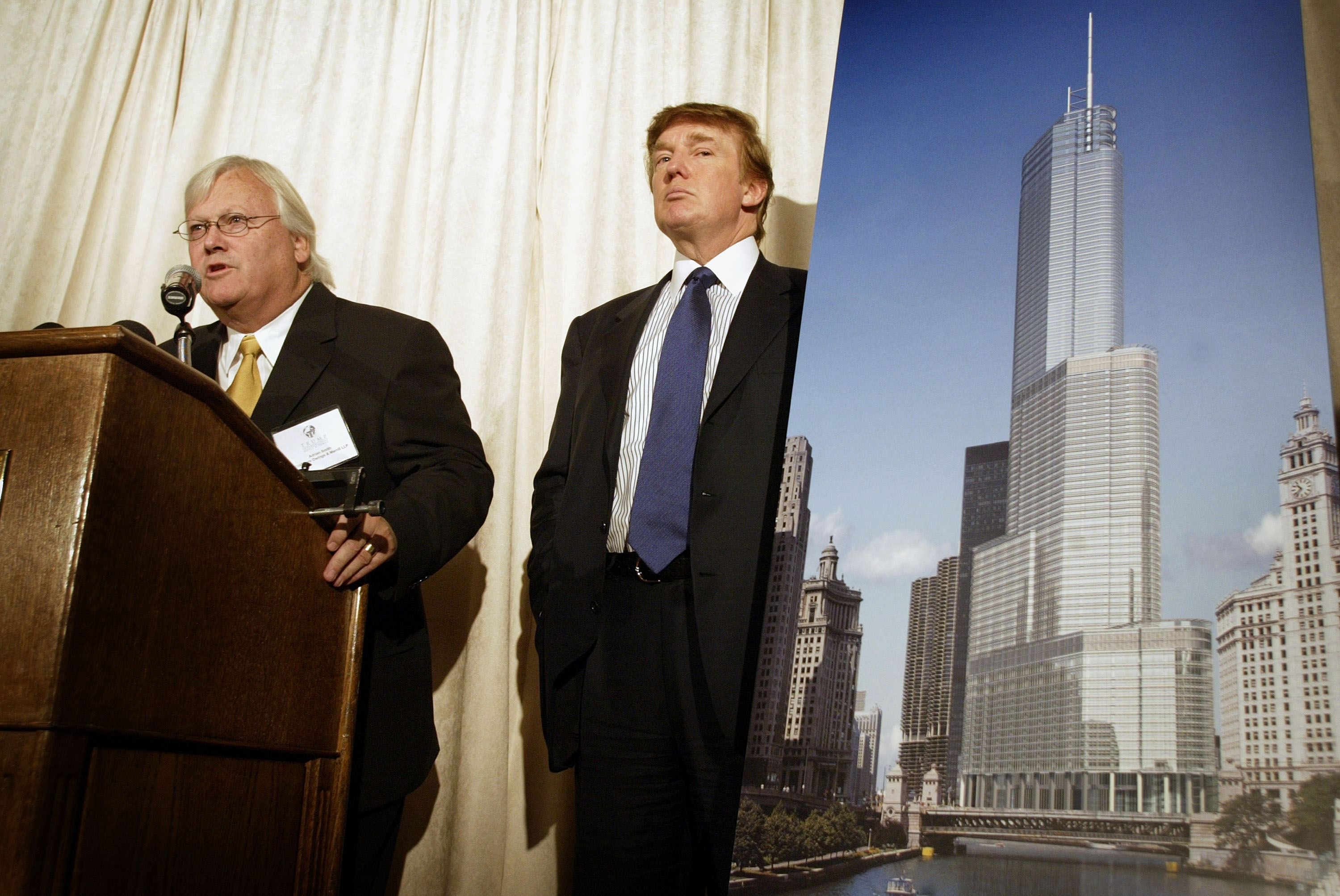 Real estate developer Donald Trump (R) and architect Adrian Smith unveil an artists rendition of Trump Tower Chicago at a news conference September 23, 2003 Chicago, Illinois. The 90-story building, was expected to be finished in 2007, and to house office, apartment, and hotel space.(Getty Images)