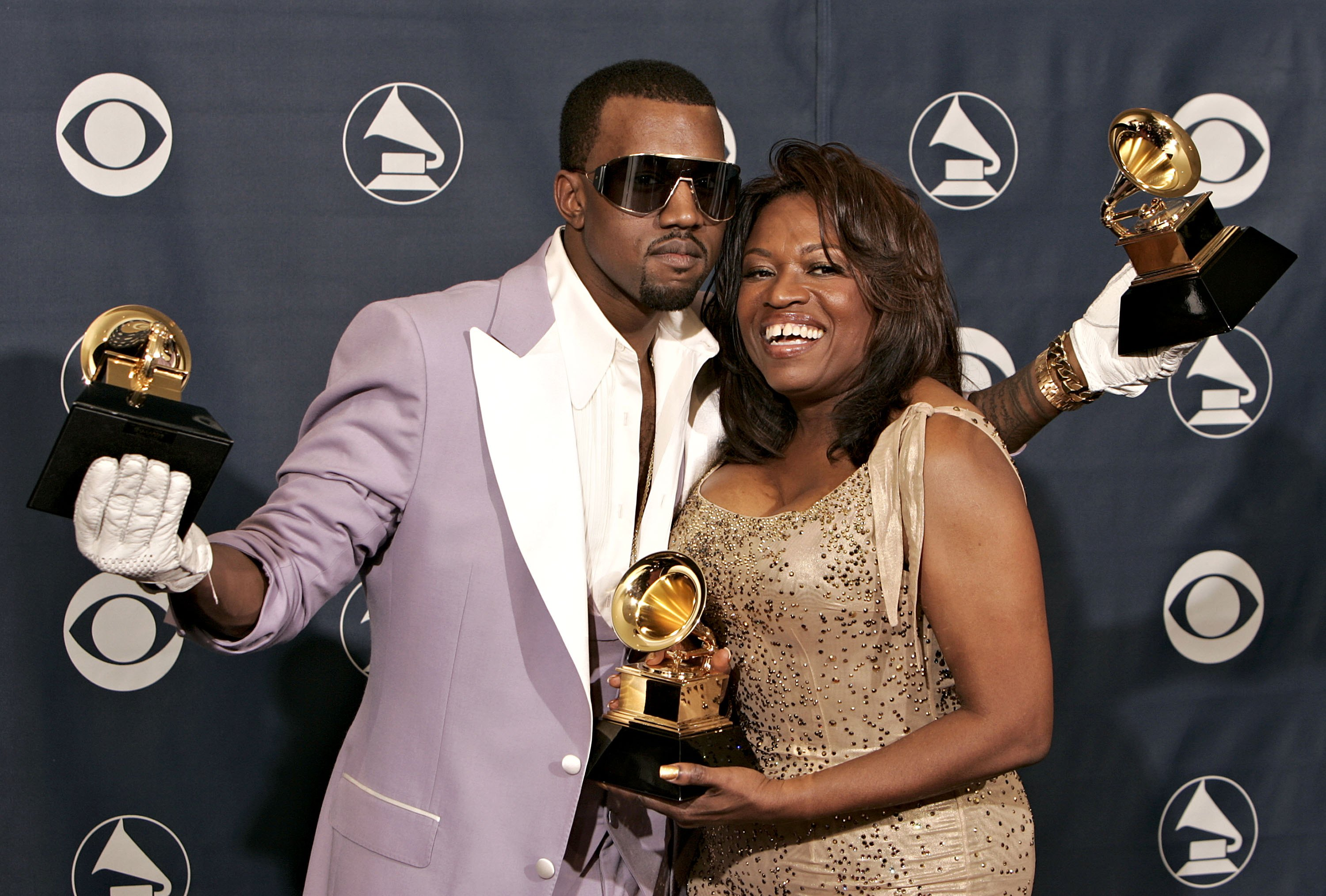 Singer Kanye West with his awards for Best Rap Song, Best Rap Solo Performance and Best Rap Album with his mother Donda West pose in the press room at the 48th Annual Grammy Awards at the Staples Center on February 8, 2006 in Los Angeles, California. (Photo by Kevin Winter/Getty Images)