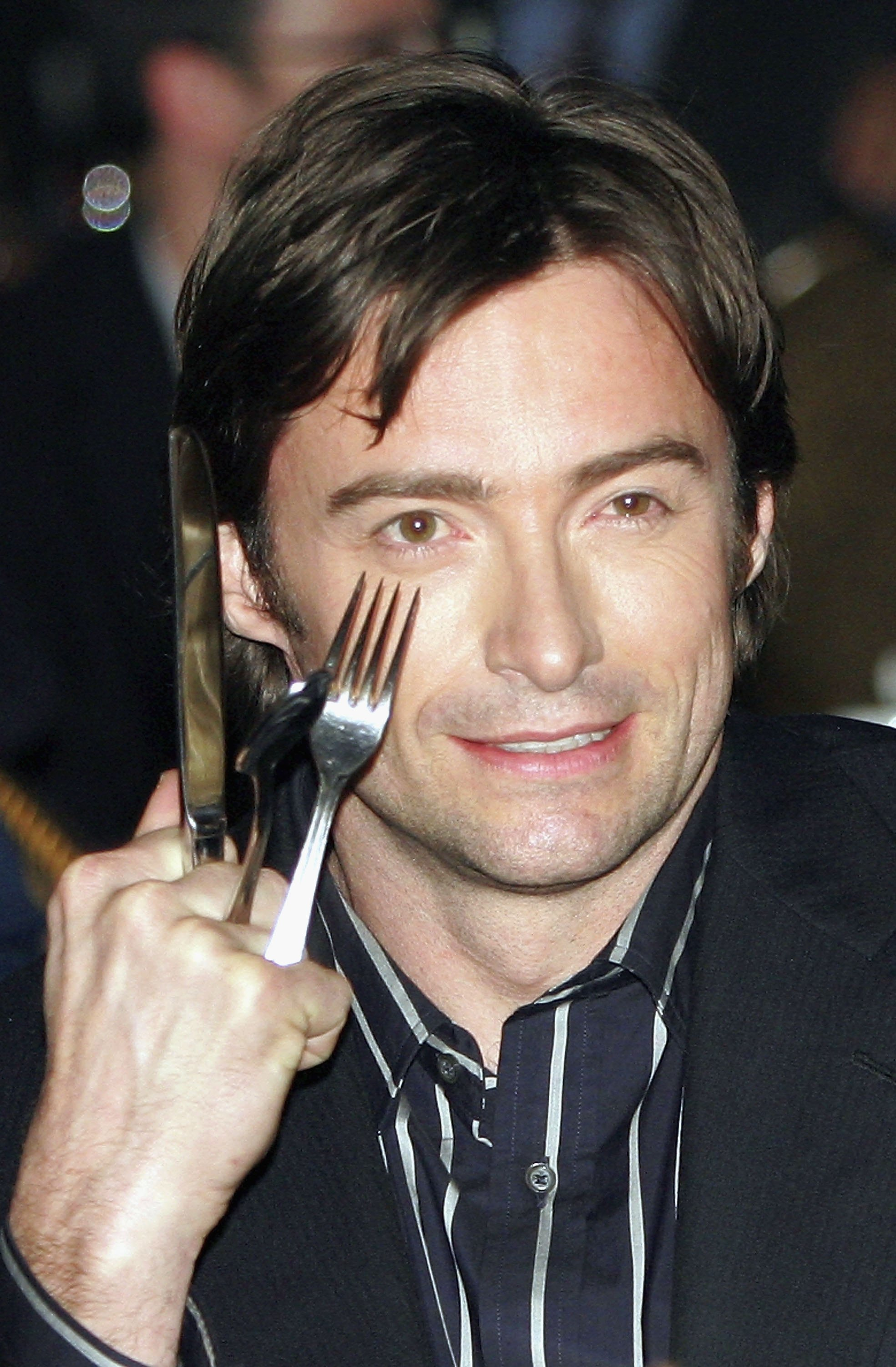 Actor Hugh Jackman jokes about his Wolverine character in the audience during the final banquet and awards ceremony for ShoWest 2006, the official convention of the National Association of Theatre Owners March 16, 2006, in Las Vegas, Nevada. (Getty Images)