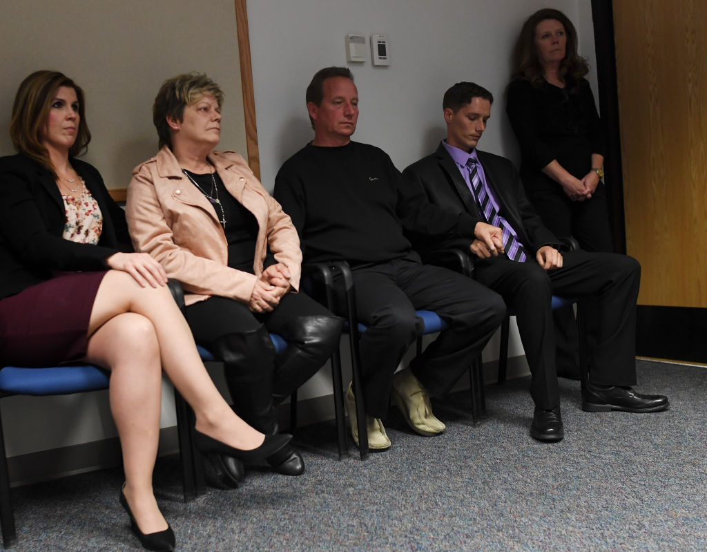 Second from left, Sandra Onorati Rzucek, Frank Rzucek, the mother and father of Shanann Watts, and her brother Frankie Rzucek hold hands as they listen to the Weld County District Attorney, Michael J. Rourke, during a press conference, at the Weld County Courthouse on November 6 (Source: RJ Sangosti/The Denver Post via Getty Images)