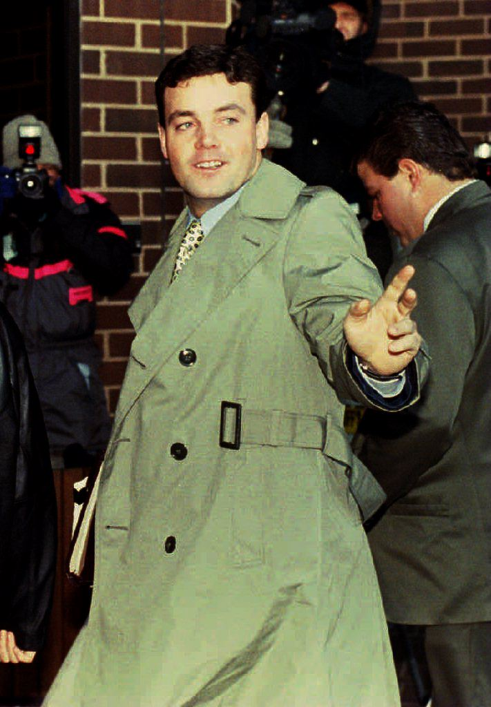 John Wayne Bobbitt points toward photographers as he arrives at the Prince William County Courthouse in Manassas, VA 18 January 1994 for the fifth day of his wife Lorena's trial for malicious wounding (Source: JENNIFER YOUNG/AFP/Getty Images)