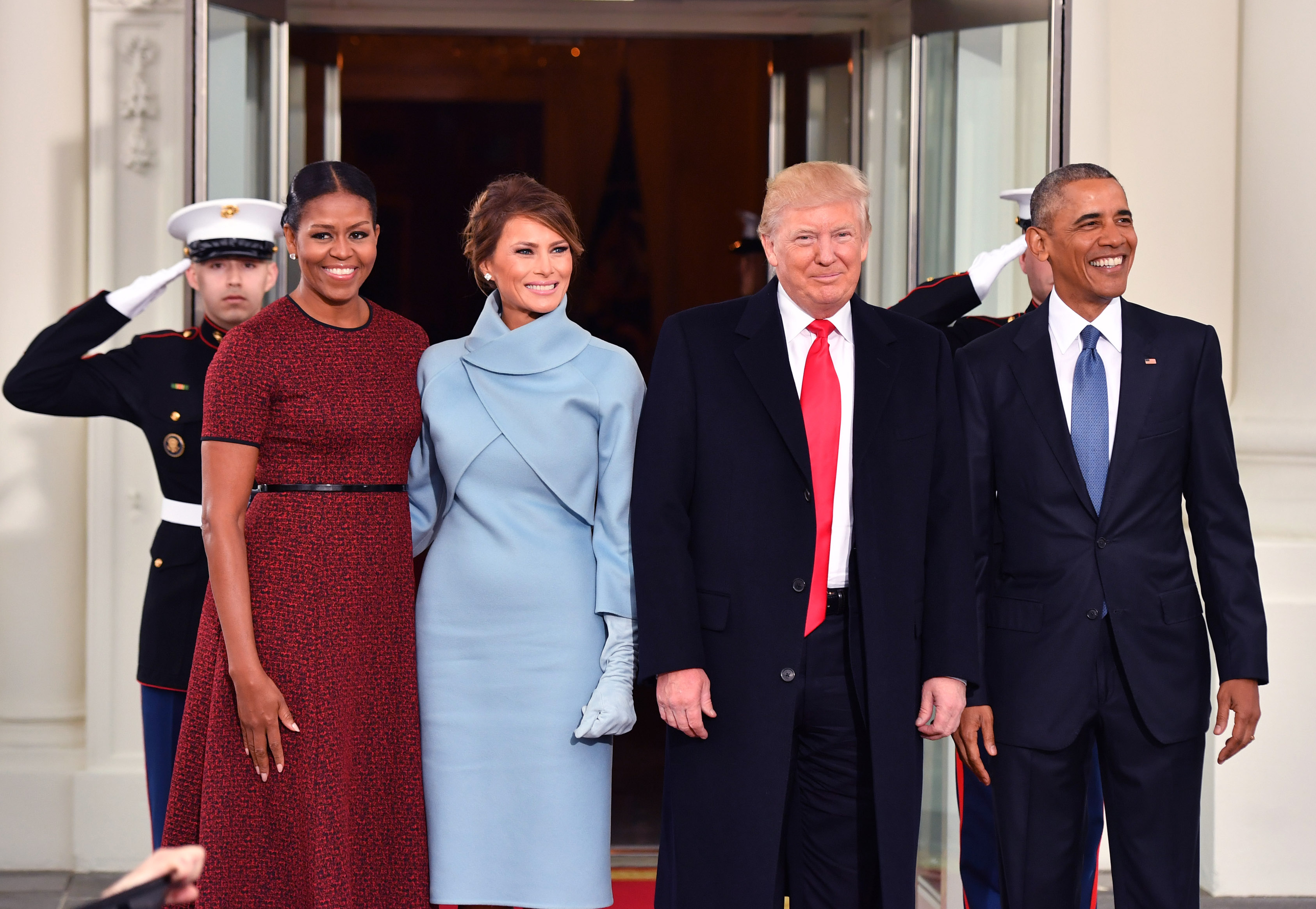 President Barack Obama (R) and Michelle Obama (L) pose with President-elect Donald Trump and wife Melania at the White House before the inauguration on January 20, 2017 in Washington, D.C. Trump becomes the 45th President of the United States. (Photo by Kevin Dietsch-Pool/Getty Images)