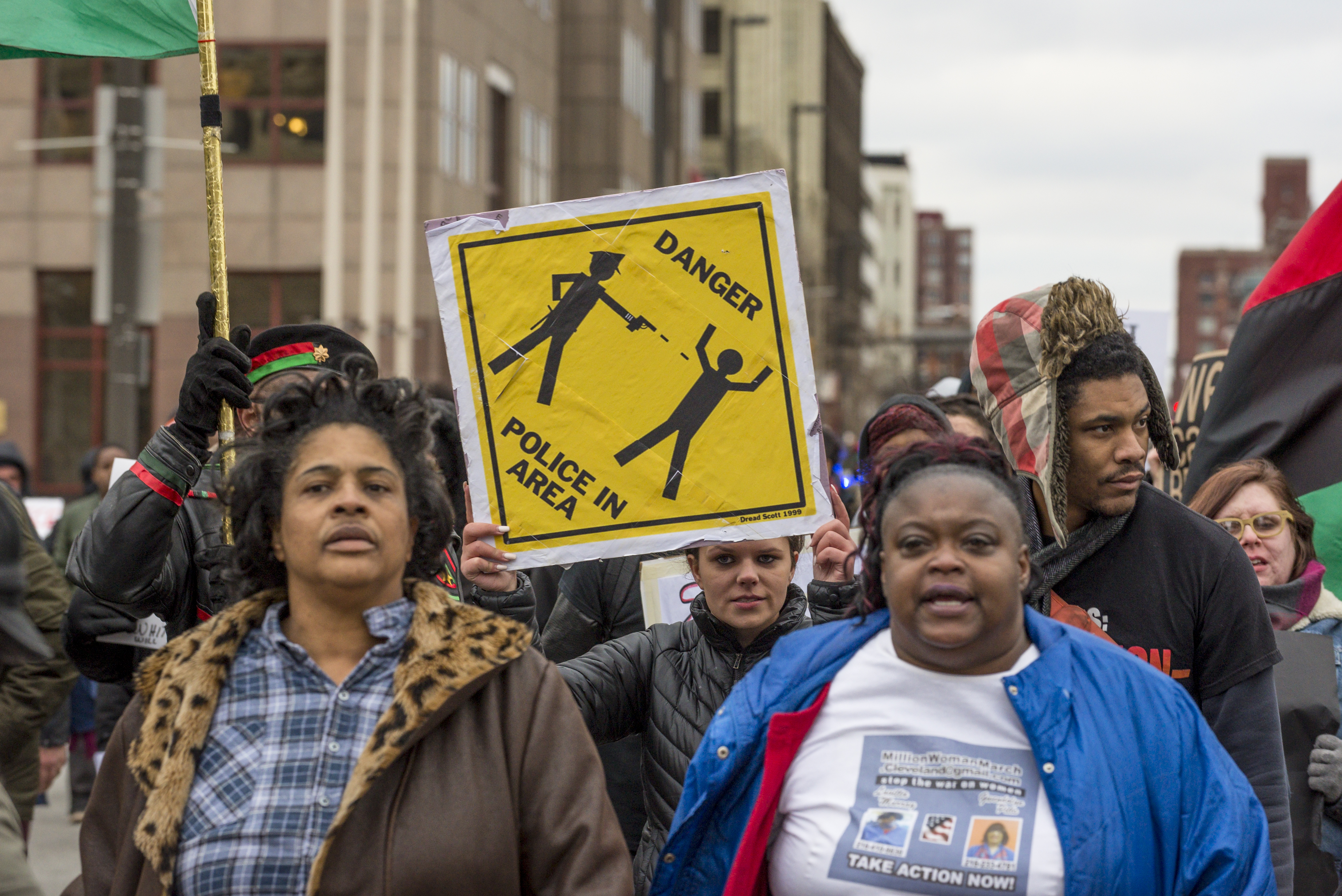 Katy Kostenko (Holding sign), a 19-year old resident of Cleveland, marches with other activists on St Clair Ave. on December 29, 2015, in Cleveland, Ohio. (Getty)