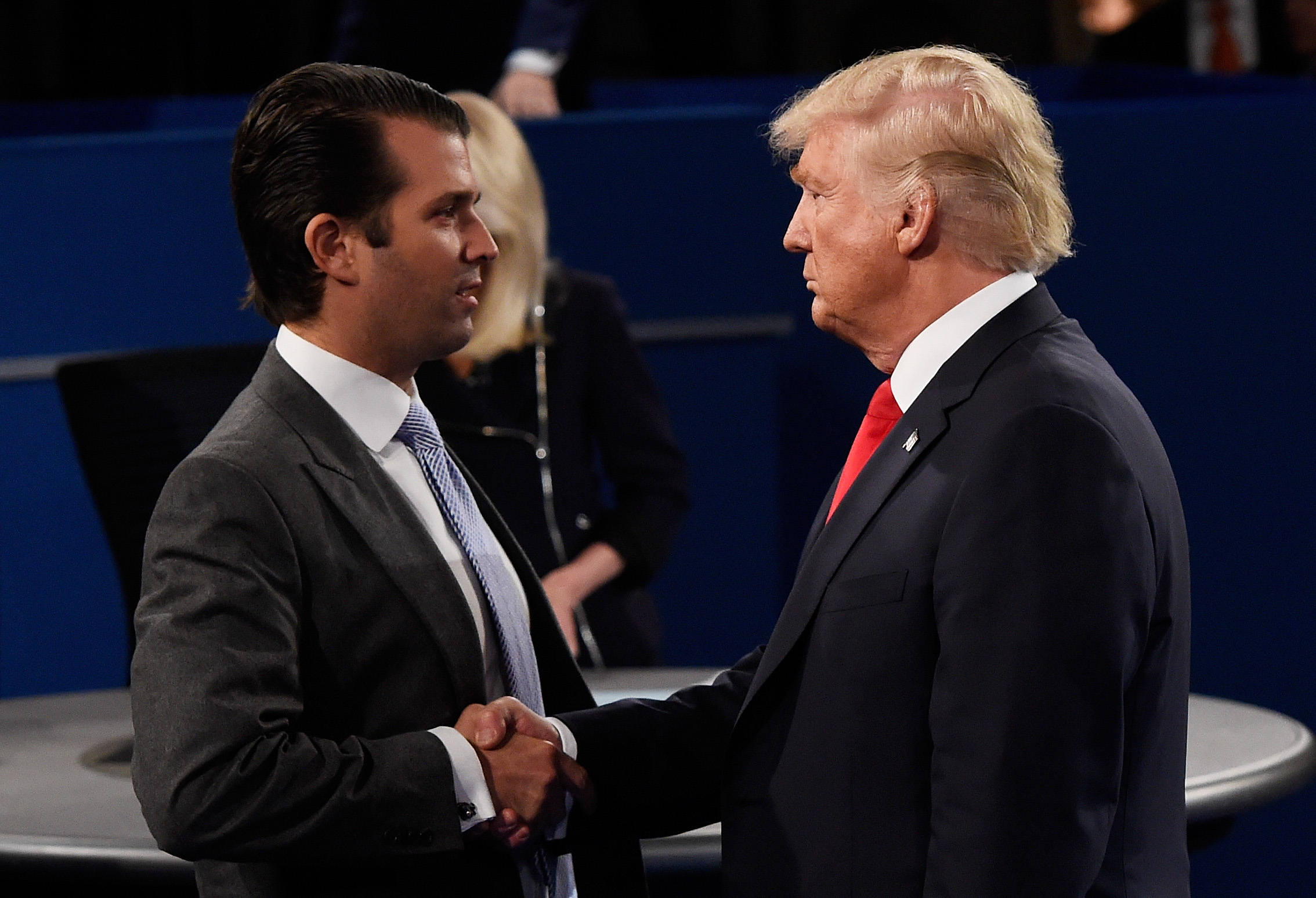 Donald Trump, Jr. (L) greets his father Republican presidential nominee Donald Trump during the town hall debate at Washington University on October 9, 2016 in St Louis, Missouri. (Getty Images)