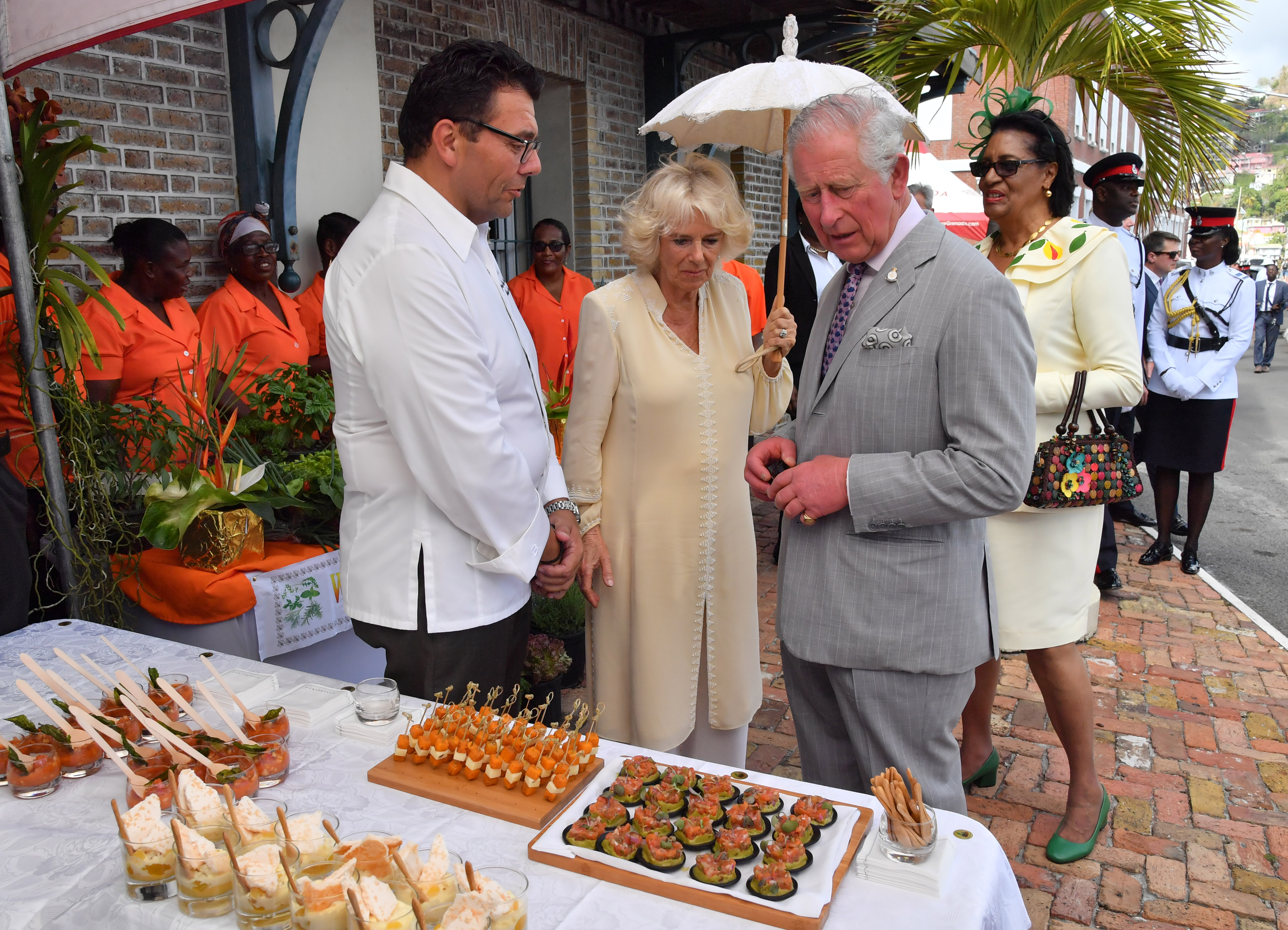 Prince Charles, Prince of Wales and Camilla, Duchess of Cornwall visit a market during their visit to Grenada on March 23, 2019 in Saint George's, Grenada.(Photo by Arthur Edwards - WPA Pool/Getty Images)