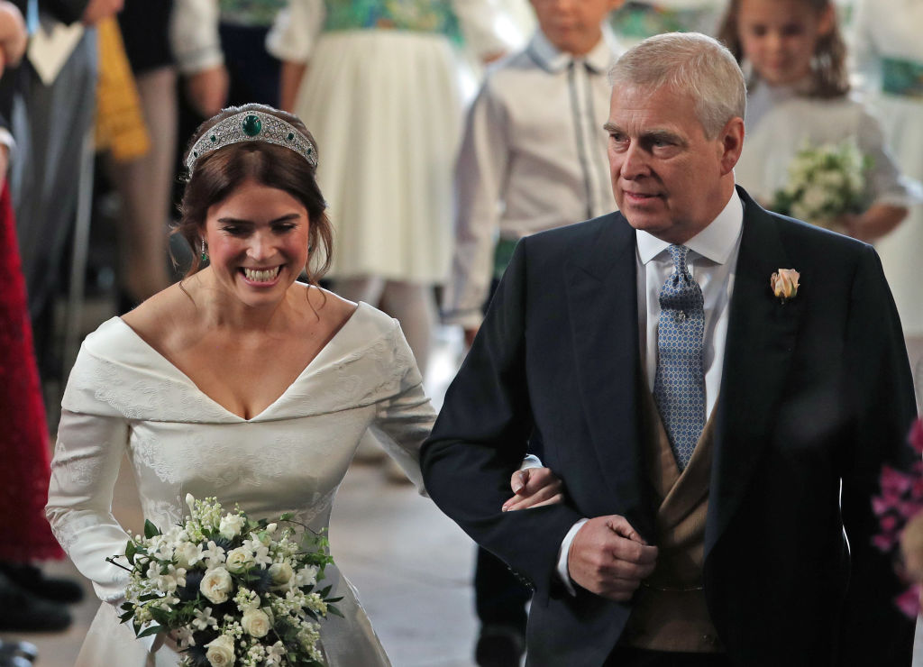 Princess Eugenie walks down the aisle with her father, Prince Andrew, the Duke of York, for her wedding to Jack Brooksbank at St George's Chapel in Windsor Castle on October 12, 2018, in Windsor, England. (Getty Images)