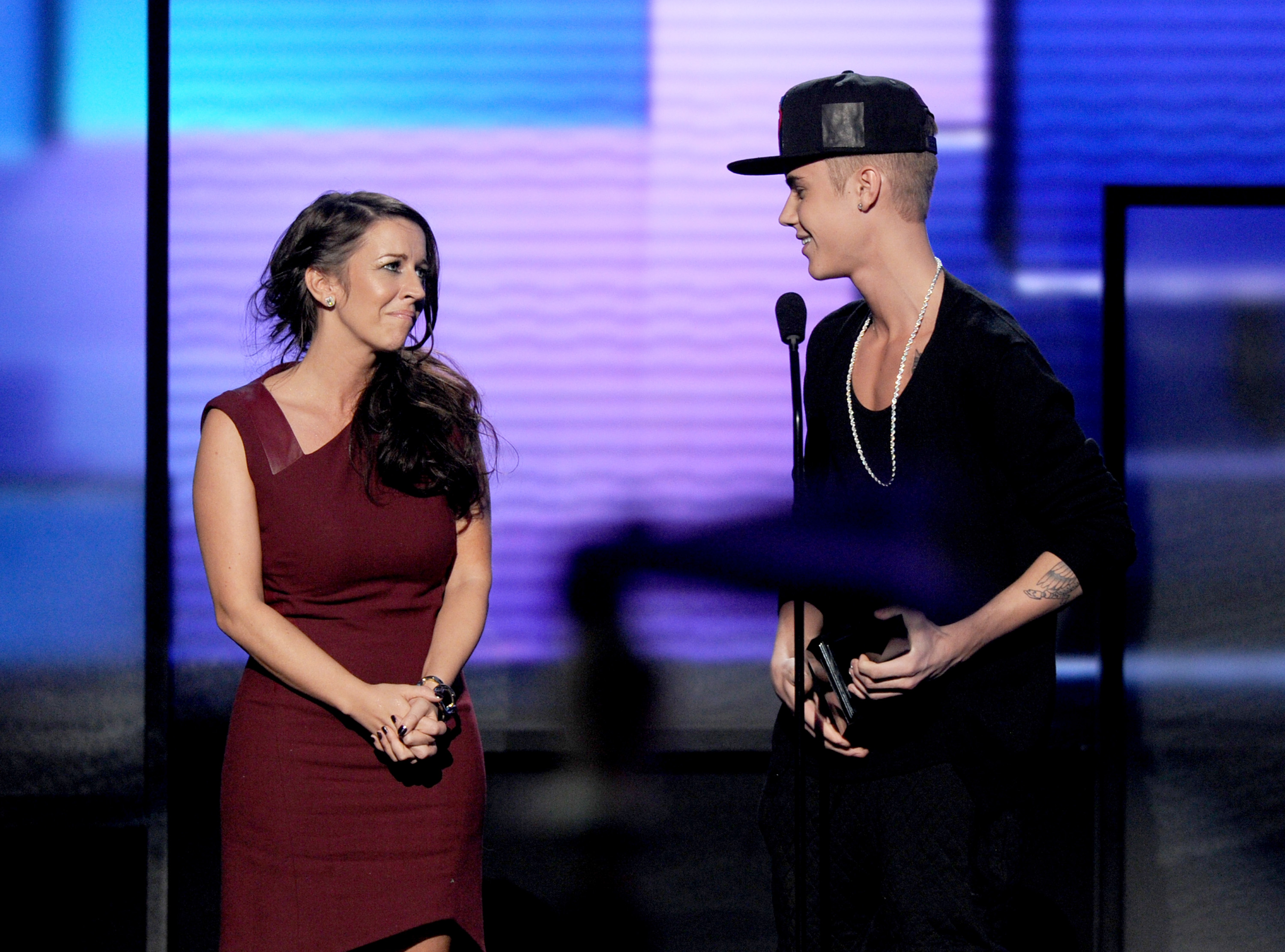 Singer Justin Bieber (R) accepts the award for Artist of the Year with Pattie Malette onstage during the 40th American Music Awards held at Nokia Theatre L.A. Live on November 18, 2012 in Los Angeles, California.