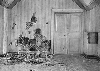 The basement where the Romanov family was killed. The wall had been torn apart in search of bullets and other evidence by investigators in 1919. The double doors leading to a storeroom were locked during the execution. (Wikipedia)