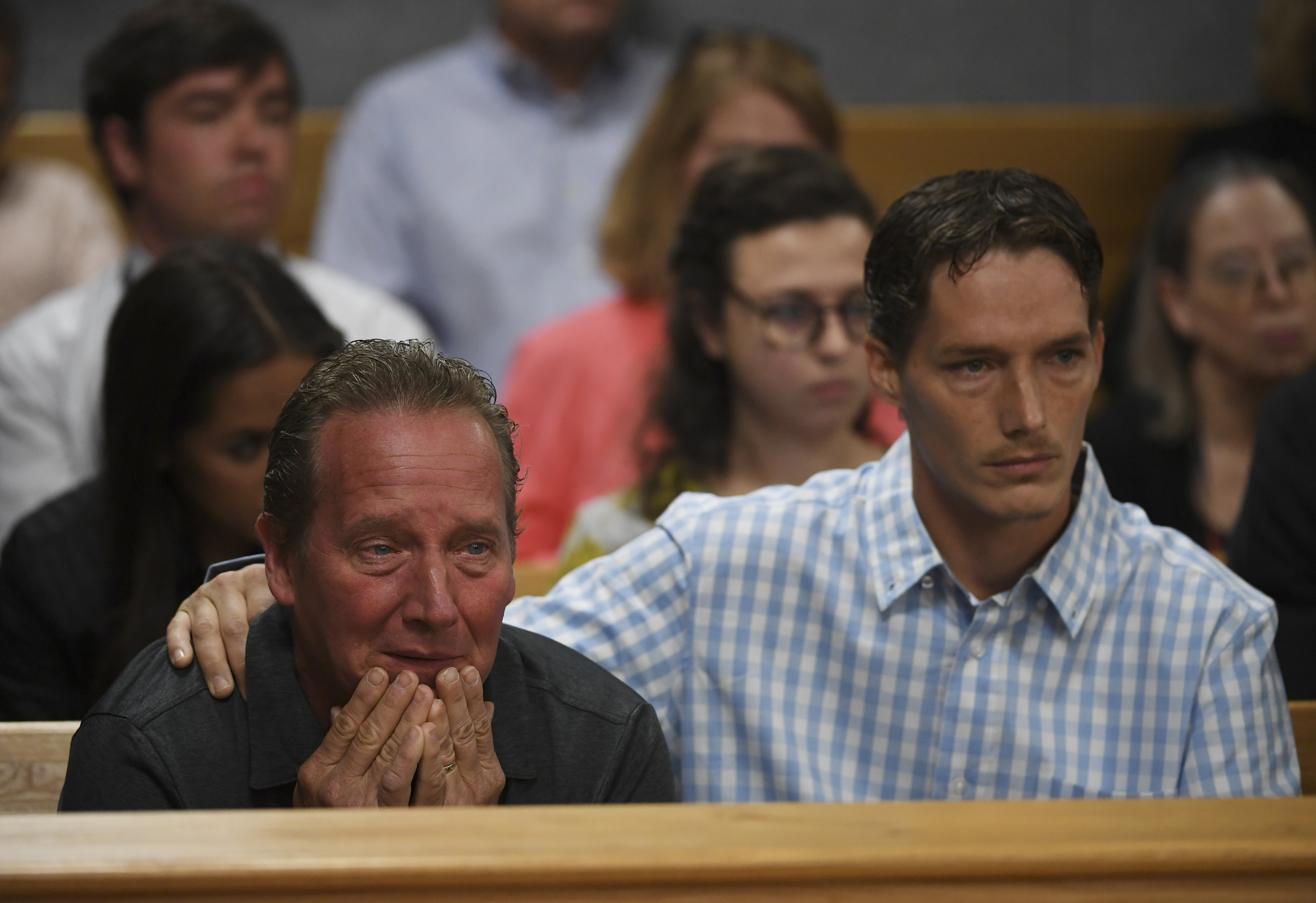 Frank Rzucek the father of Shanann Watts, left, and her brother Frankie Rzucek were in court for Christopher Watts arraignment hearing at the Weld County Courthouse on August 21, 2018 in Greeley, Colorado. Christopher Watts faces nine charges, including several counts of first-degree murder of his wife Shanann and his two young daughters, 4-year-old Bella, and 3-year-old Celeste.