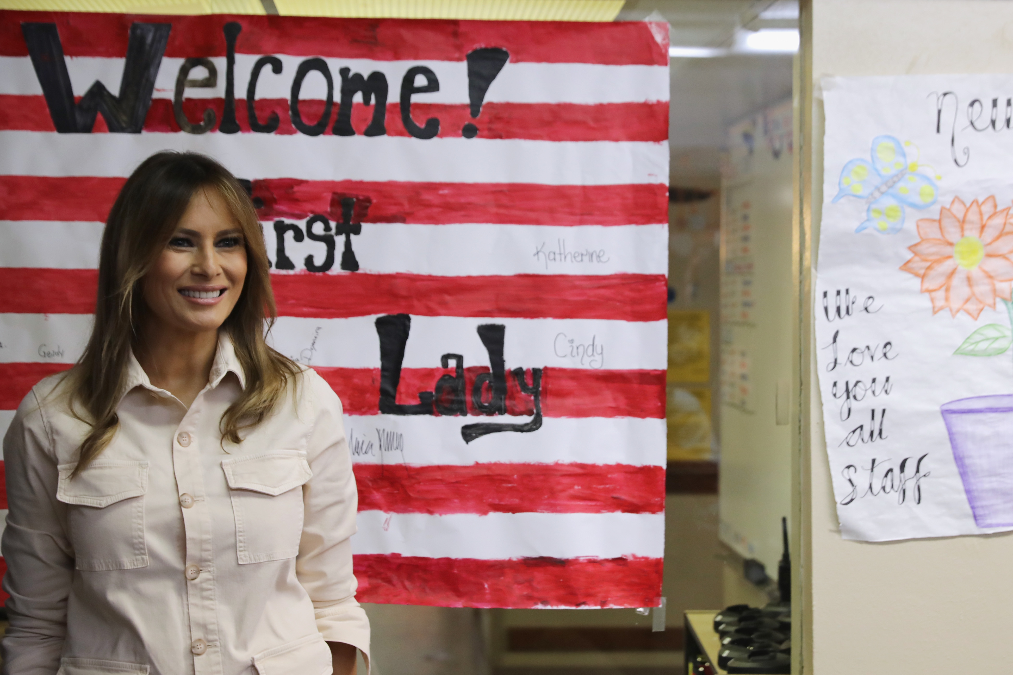 U.S. First Lady Melania Trump smiles after signing a welcome poster made for her after a round table discussion with doctors and social workers at the Upbring New Hope Childrens Center operated by Lutheran Social Services of the South and contracted with the Department of Health and Human Services June 21, 2018 in McAllen, Texas. The first lady traveled to Texas to see first hand the condition and treatment that migrant children taken from their families at the U.S.-Mexico border are receiving from the federal government. Following public outcry and criticism from members of his own party, President Donald Trump signed an executive order Wednesday to stop the separation of migrant children from their families, a practice the administration employed to deter illegal immigration at the border.