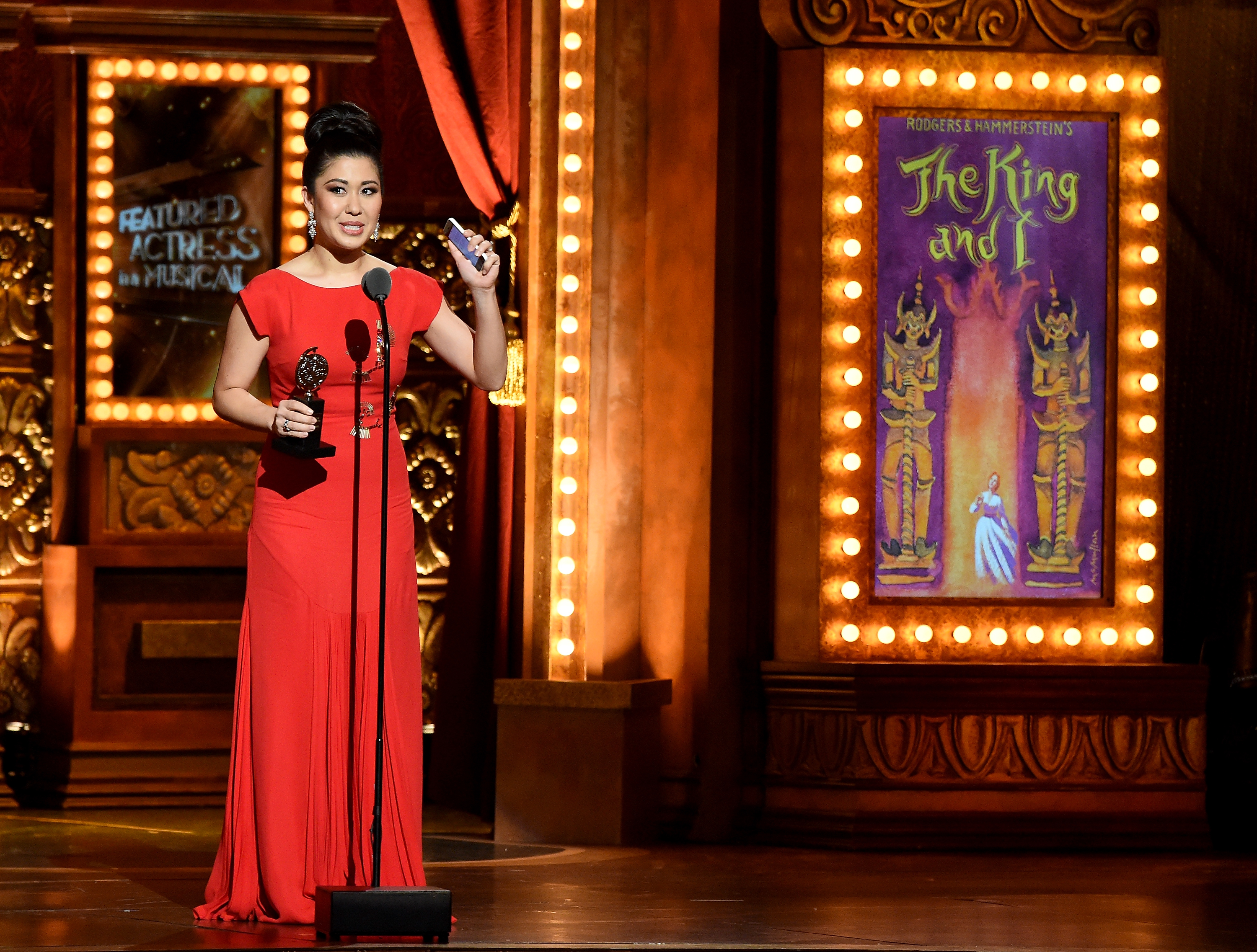 "Ruthie Ann Miles accepts the award for Best Performance by an Actress in a Featured Role in a Musical for ""The King and I "" onstage at the 2015 Tony Awards at Radio City Music Hall on June 7, 2015, in New York City. (Getty)"
