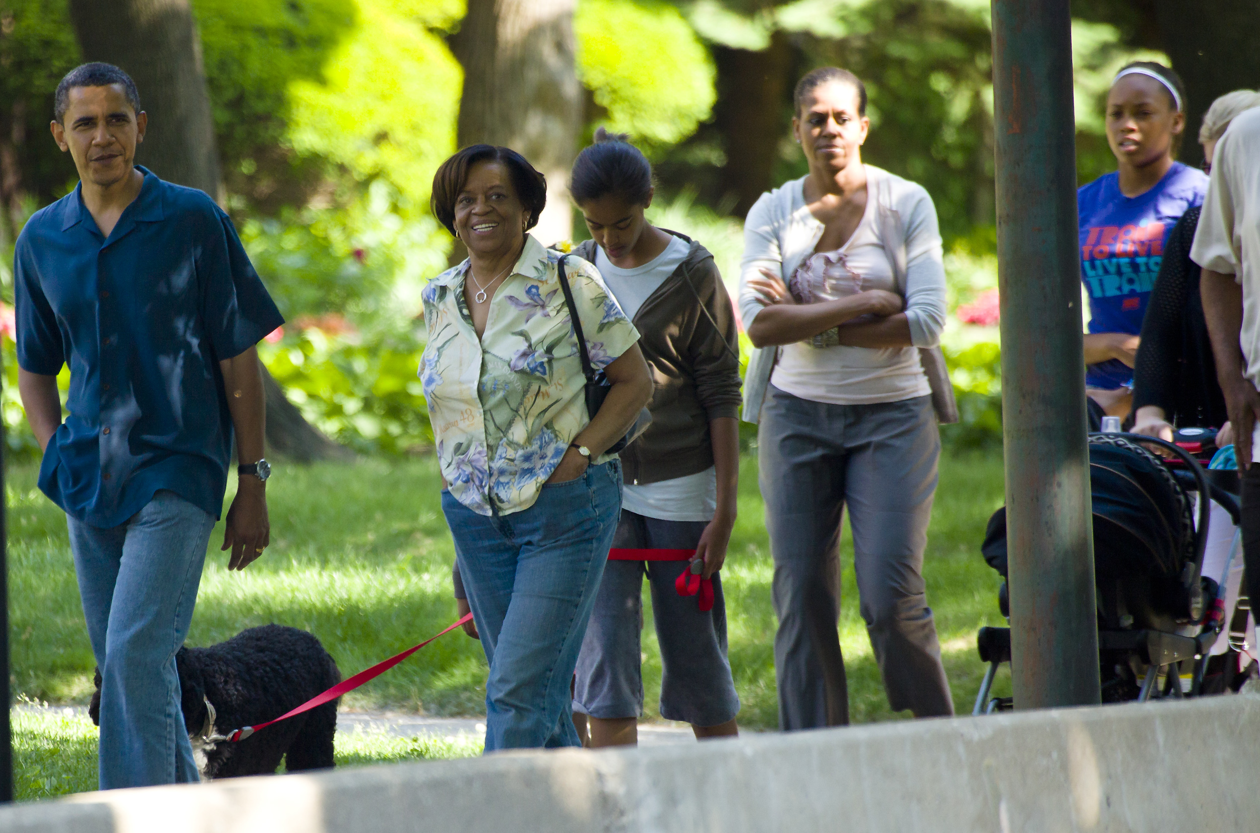 President Barack Obama takes a walk down the street from his home accompanied by his mother-in-law Marian Robinson, daughter Malia Obama, First Lady Michelle Obama Obama and dog Bo May 29, 2010, in Chicago, Illinois. (Getty Images)