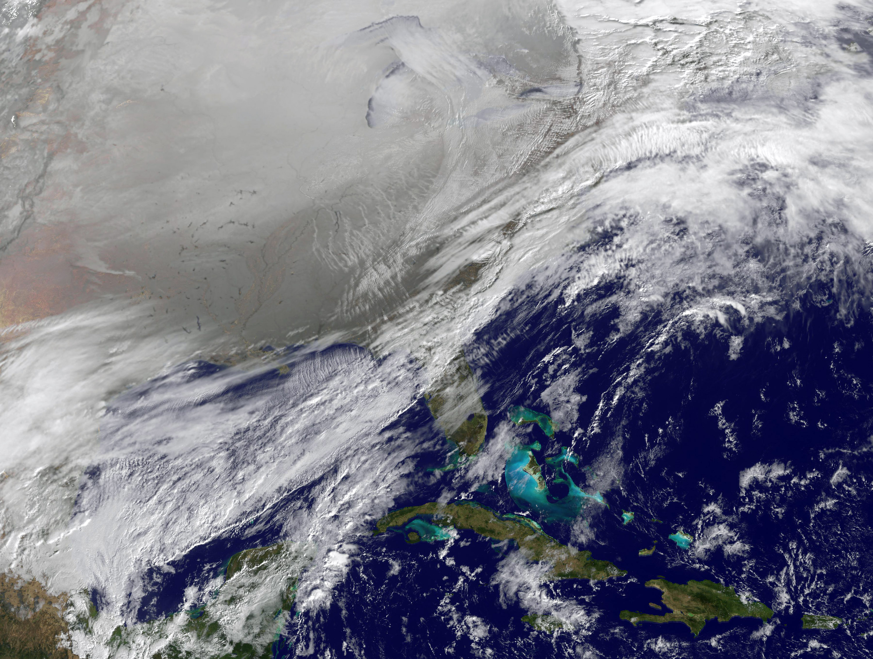 In this satellite handout image provided by National Oceanic and Atmospheric Administration (NOAA), shows the entry of a large area of low pressure, from the Polar Vortex, into the Northern U.S. January 6, 2014. (Getty Images)