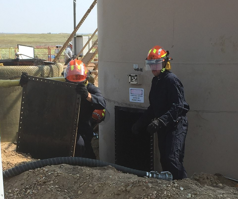 The oil stored in the 400-barrel tanks at the remote oil site owned by Anadarko Petroleum was manually drained by workers who carefully poured the liquid over metal screens to collect any evidence. (Source: Weld County DA)
