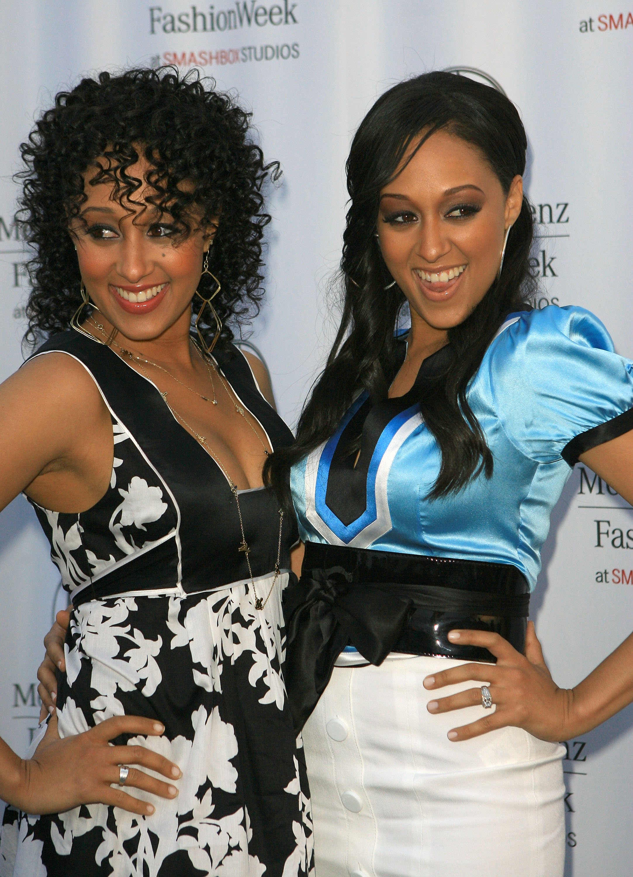 Actresses Tamera Mowry and Tia Mowry attends Mercedes Benz Fashion Week held at Smashbox Studios on March 18, 2007 in Culver City, California. (Photo by Katy Winn/Getty Images)