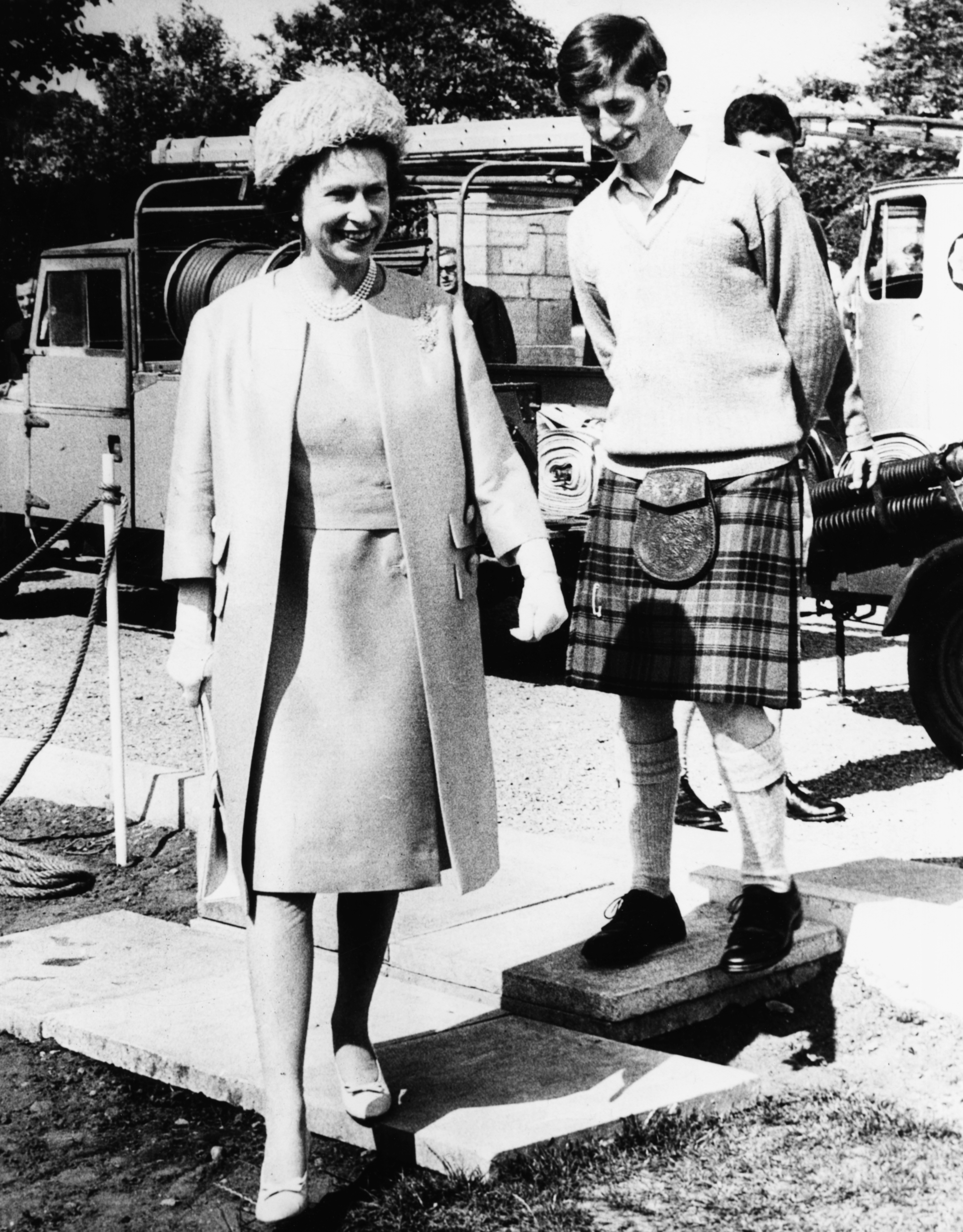 Queen Elizabeth II and Prince Charles, who is Head Boy here, pictured during a visit to Gordonstoun School, where she opened their new Sports Centre, Scotland, July 24th 1967. (Getty Images)