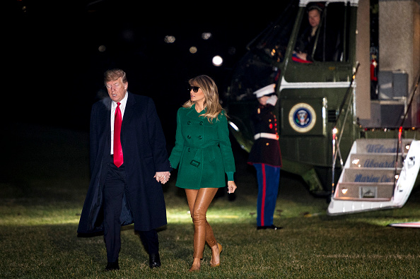 U.S. President Donald Trump and First Lady Melania Trump make their way across the South Lawn of the White House after returning on Marine One from their surprise trip to Al Asad Air Base in Iraq to visit troops, on December 27, 2018, in Washington, DC. (Getty Images)
