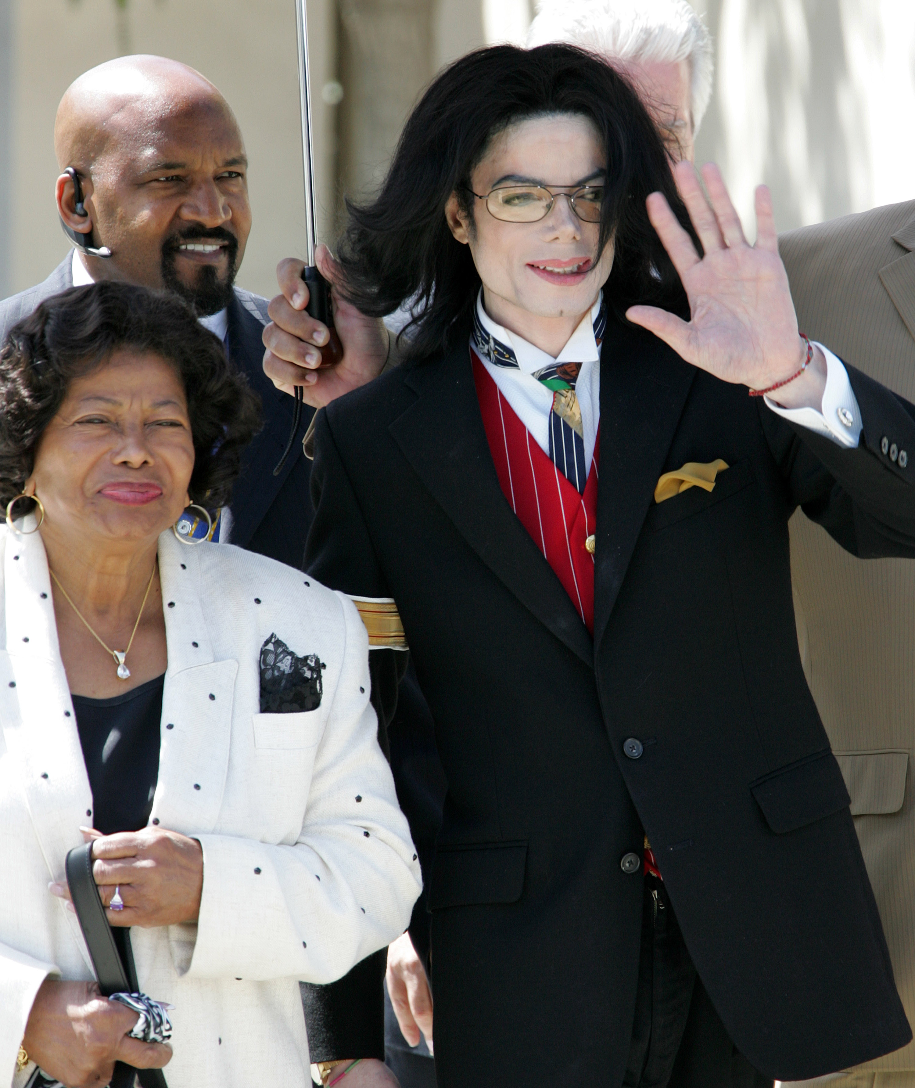 Michael Jackson waves to fans as he leaves the courthouse with his mother Katherine during his trial on child molestation charges April 11, 2005 in Santa Maria, California. Today, the mother of a teenage boy at the center of 1993 molestation accusations testified that Jackson begged her to allow the boy to share his bed. The boy stopped cooperating with police after a reported $23 million settlement from the pop star.