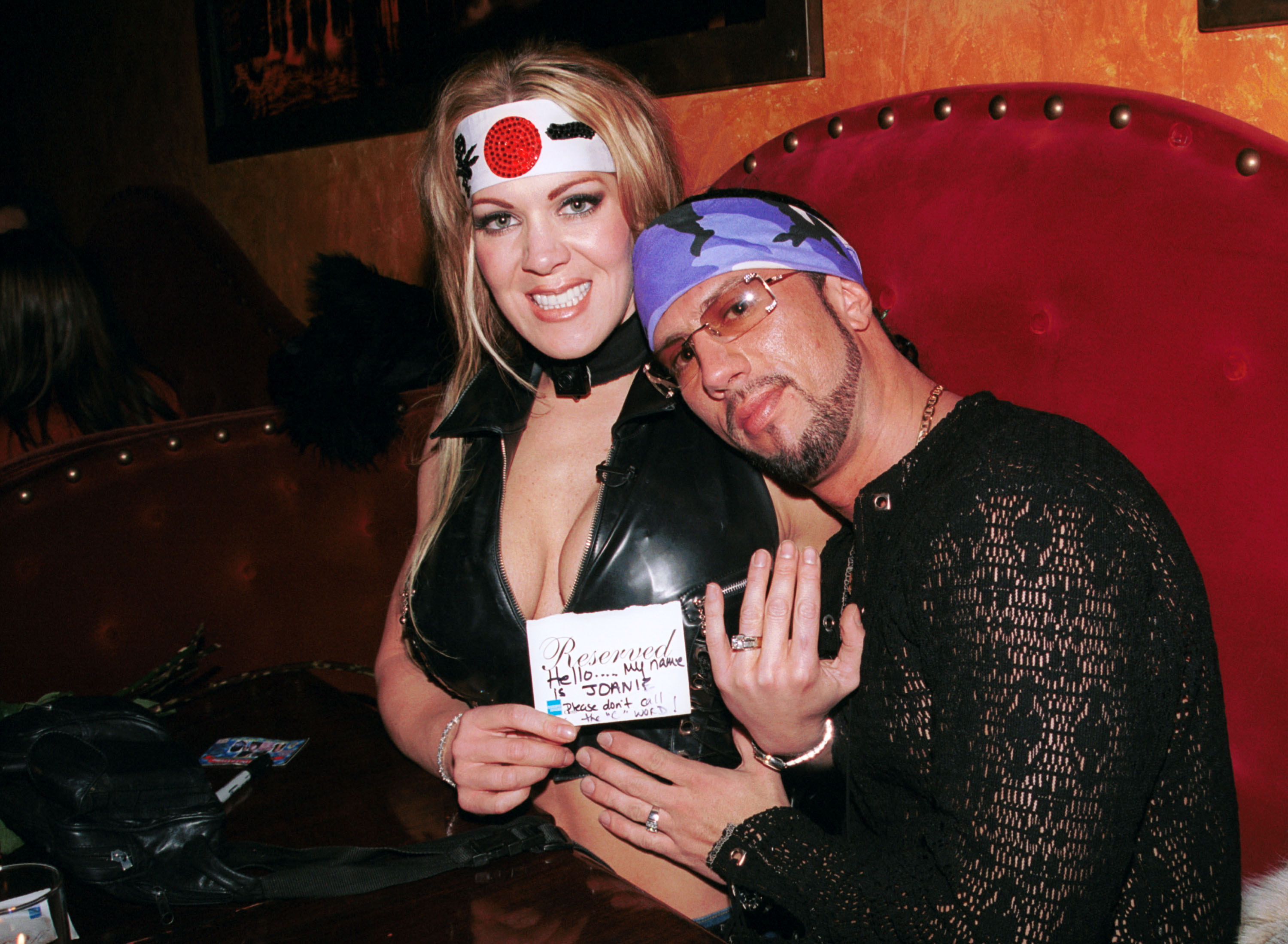 Former female wrestler Joanie Laurer poses with fiance, wrestler Sean Waltman during Barfly 5th year anniversary party on December 18, 2002 in West Hollywood, California. (Photo by David Klein/Getty Images)