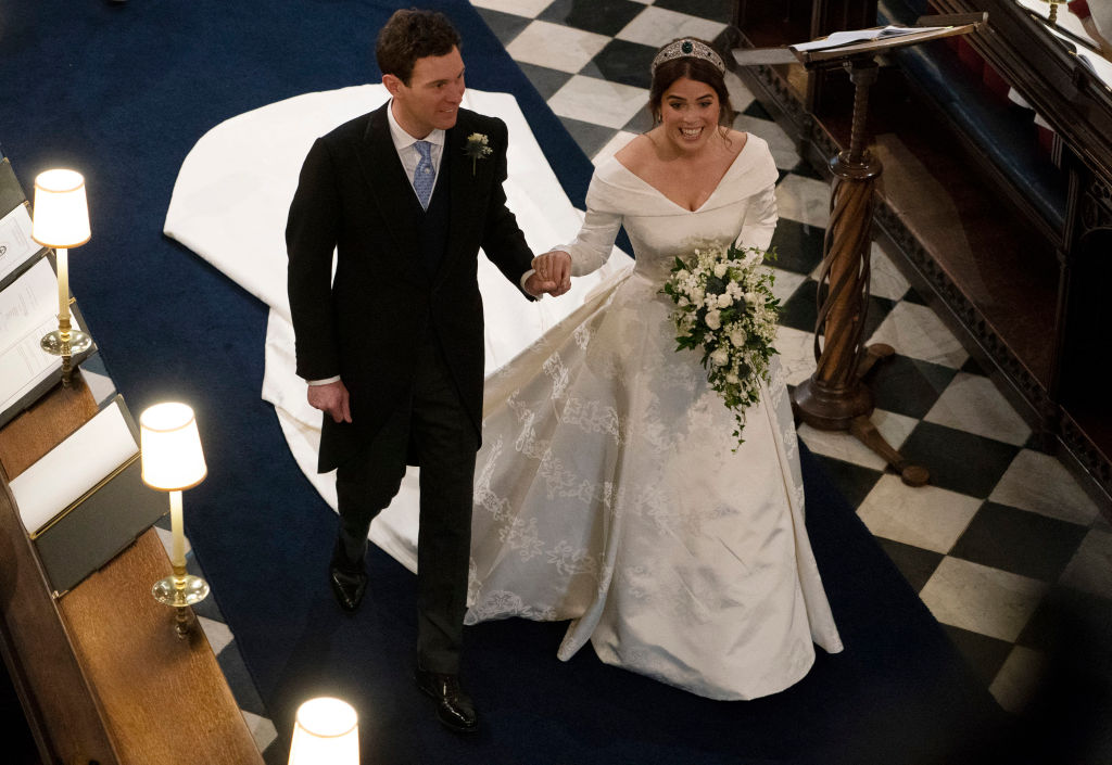 Jack Brooksbank and Princess Eugenie of York walk up the aisle after their wedding ceremony at St. George's Chapel on October 12, 2018, in Windsor, England. (Getty Images)