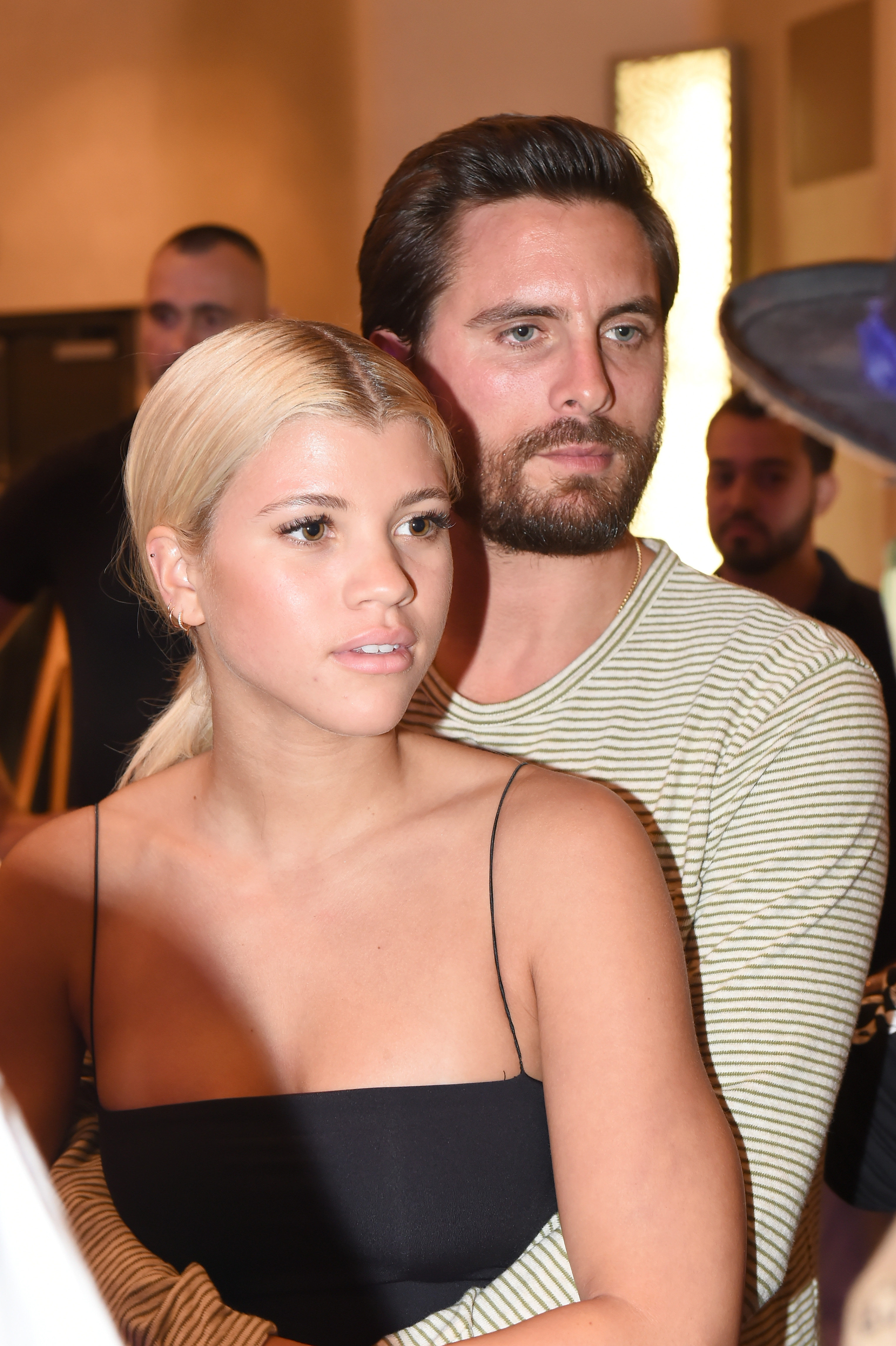 Sofia Richie (L) and Scott Disick attend Haute Living's VIP Pop-Up opening of Alec Monopoly from Art Life and David Yarrow from Maddox Gallery at Fleur De Lis Ballroom, Fontainebleau Miami Beach on December 7, 2017 in Miami Beach, Florida.